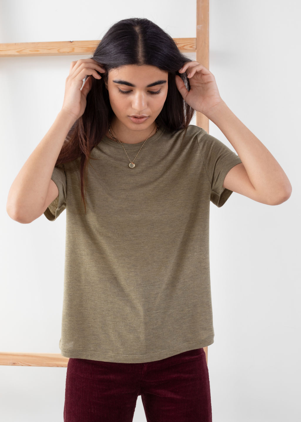 Model front image of Stories organic cotton tee in green