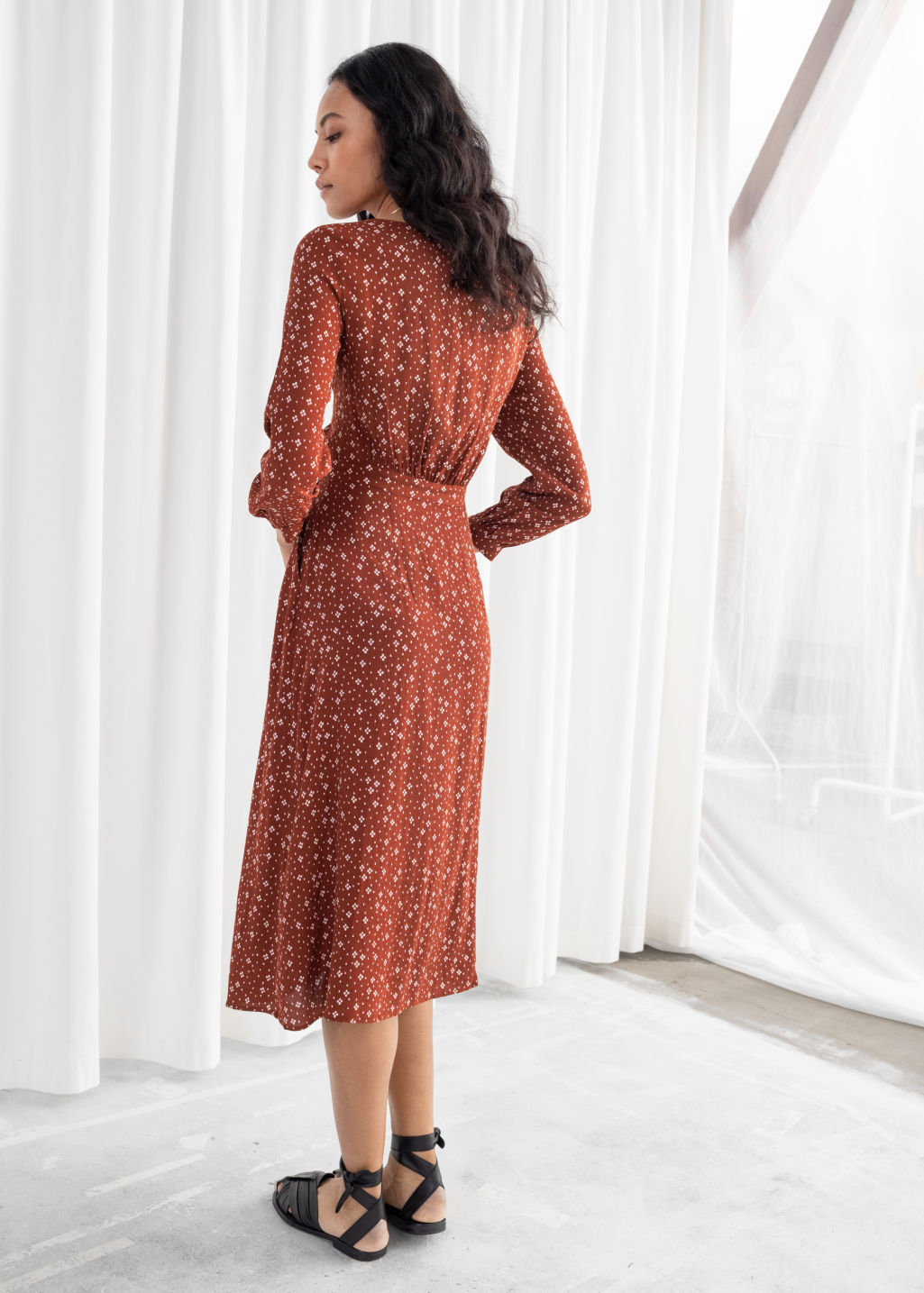 Model back image of Stories printed button up midi dress in orange