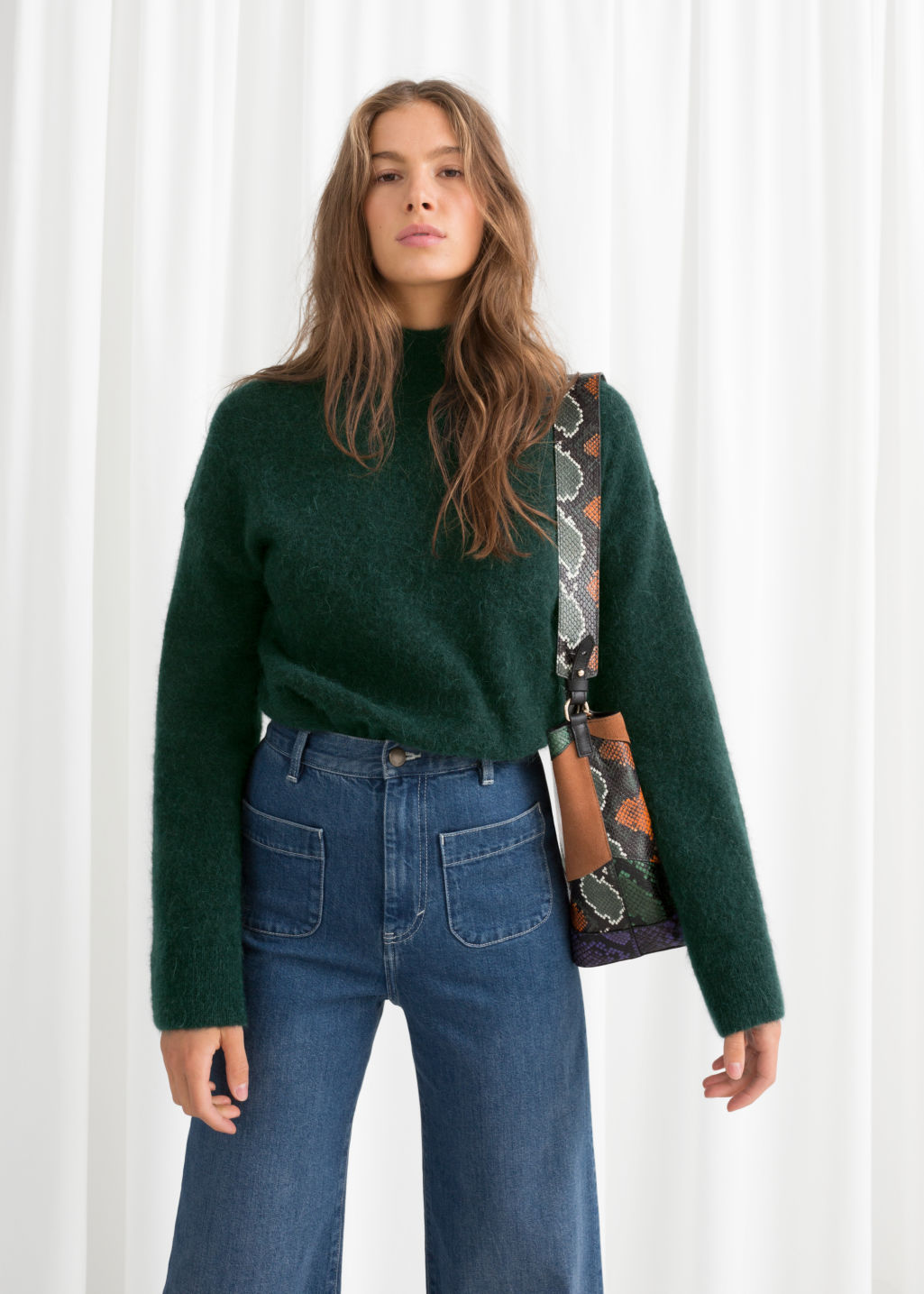Model front image of Stories bell sleeve turtleneck sweater in green