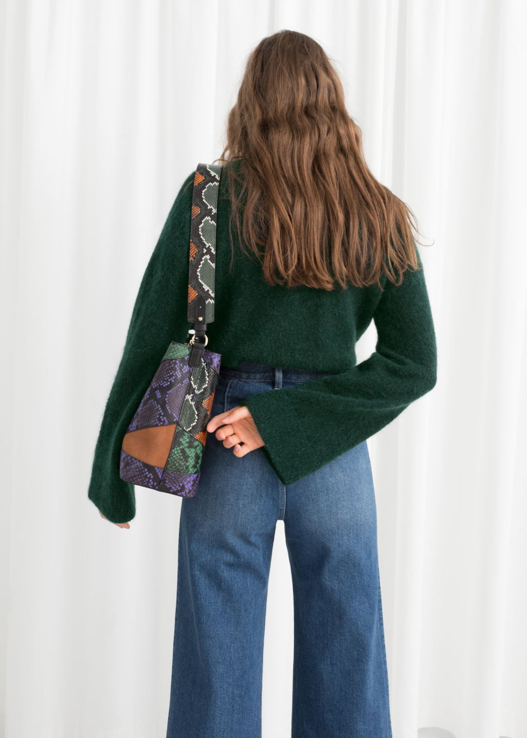 Model back image of Stories bell sleeve turtleneck sweater in green