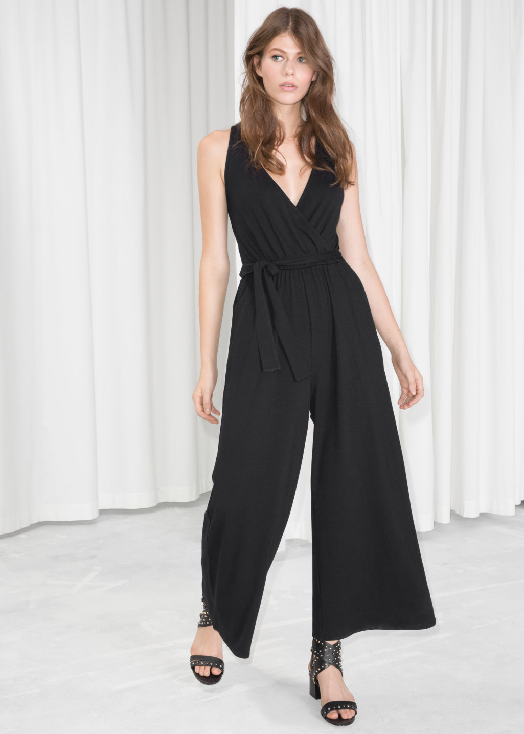 Model front image of Stories belted wrap jumpsuit  in black