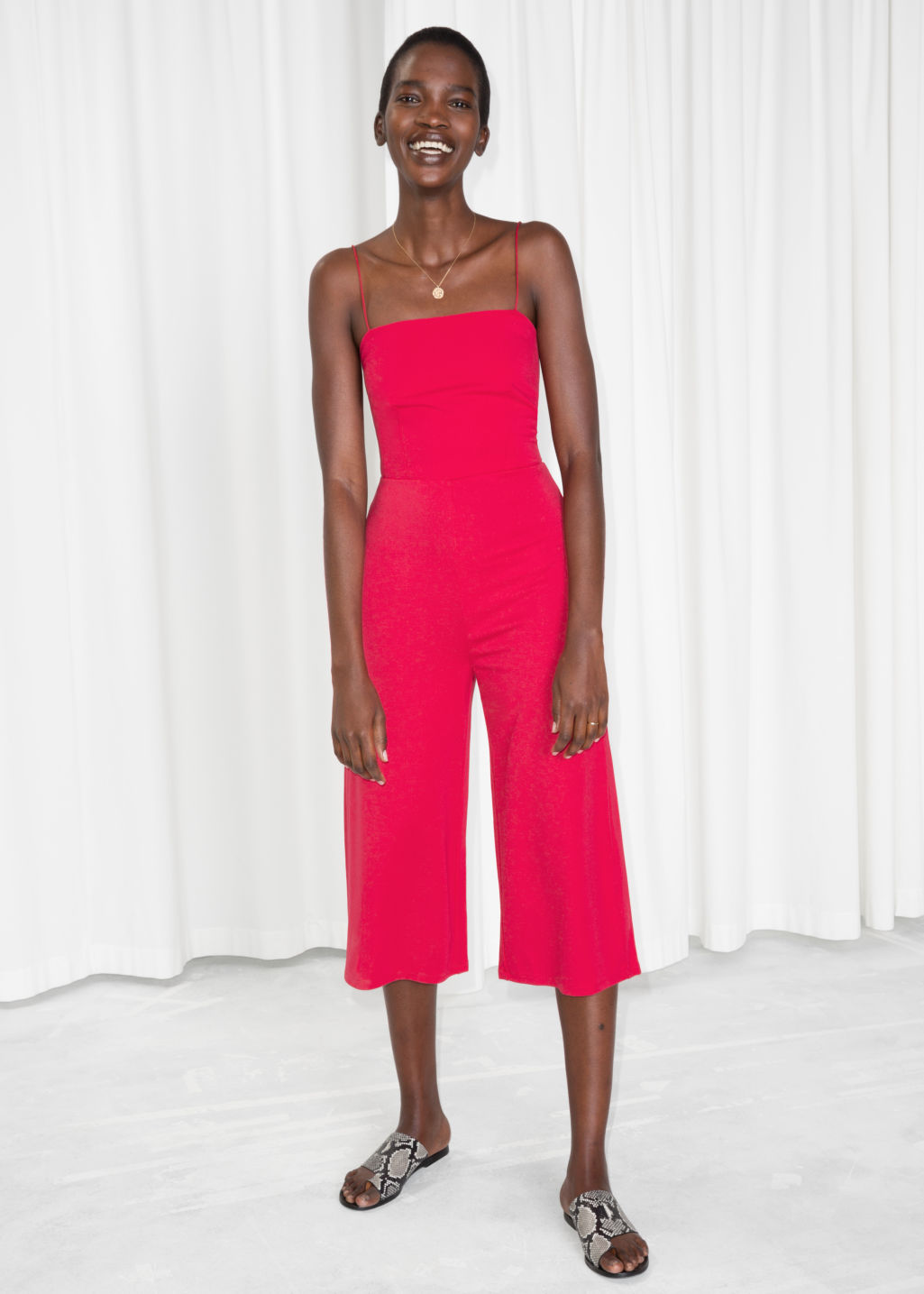 Model front image of Stories back tie jumpsuit  in red