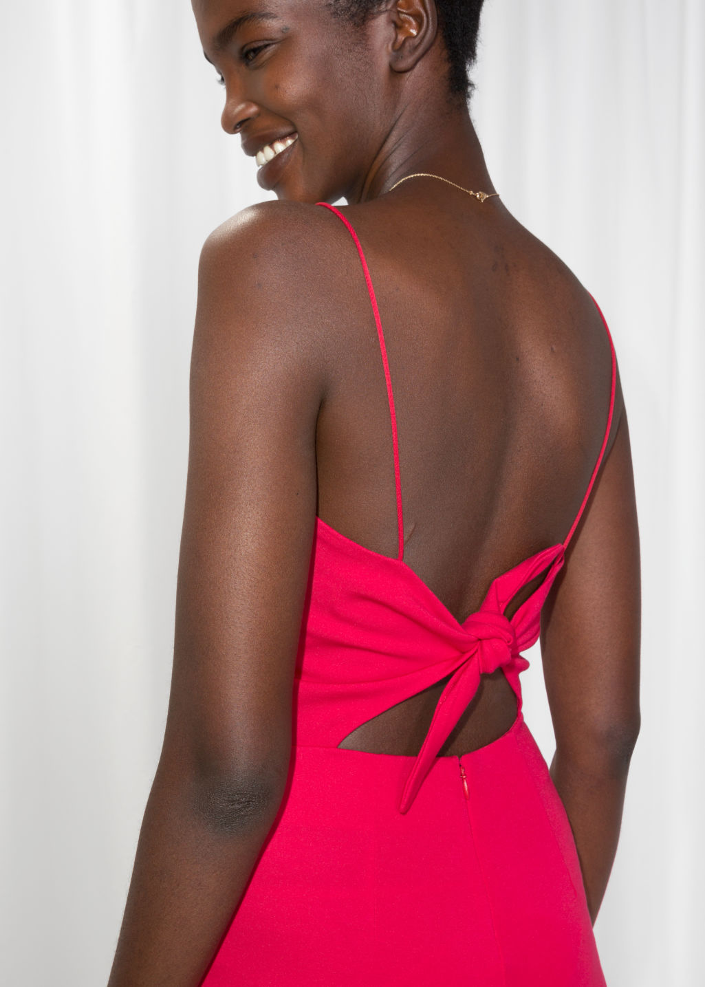 Model back image of Stories back tie jumpsuit  in red