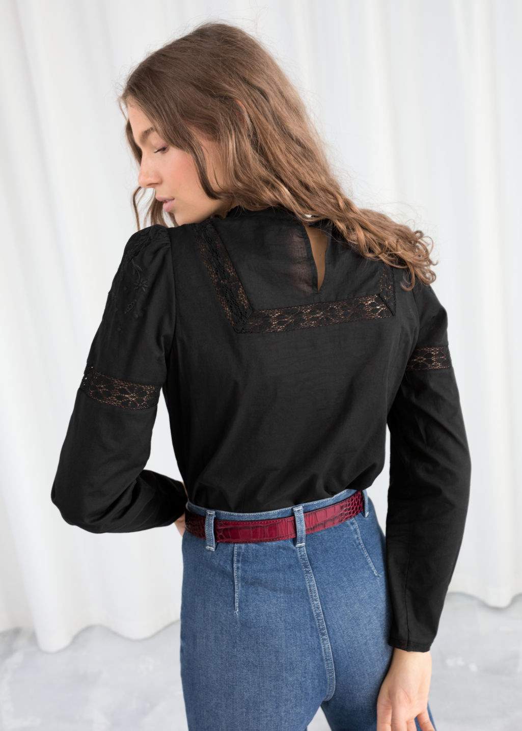 Model back image of Stories embroidered cotton blouse in black