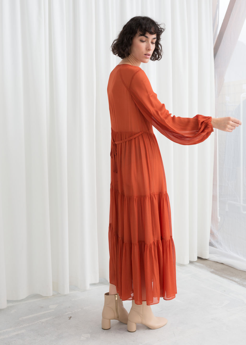 Model back image of Stories ruffle tier maxi dress in orange