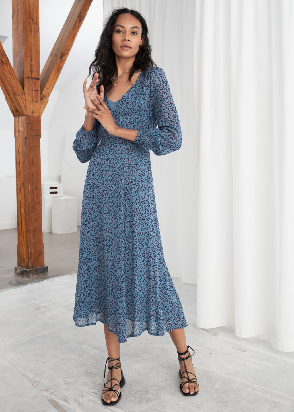 Model front image of Stories sheer printed midi dress in blue