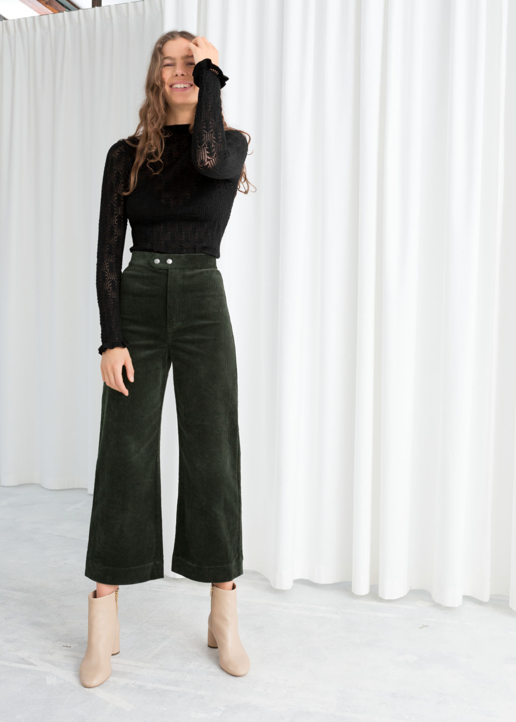 Model front image of Stories duo snap button corduroy culottes in green