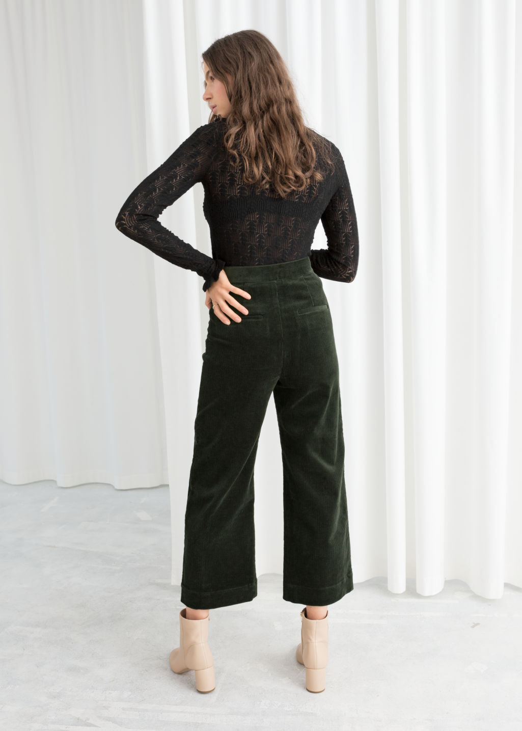 Model back image of Stories duo snap button corduroy culottes in green
