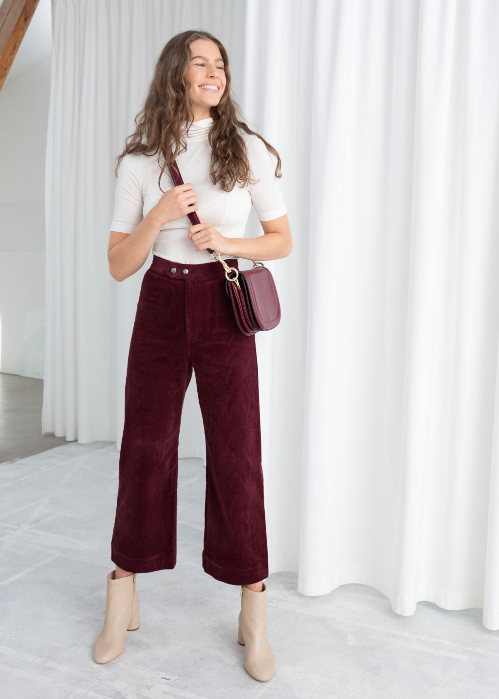 Model front image of Stories duo snap button corduroy culottes in red