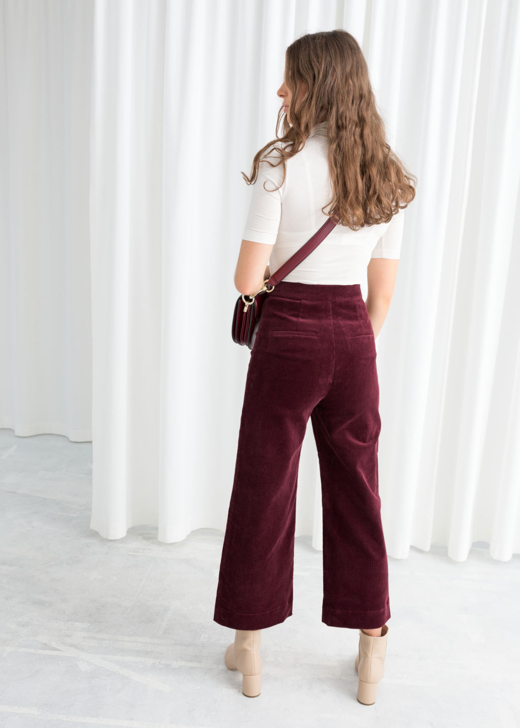 Model back image of Stories duo snap button corduroy culottes in red