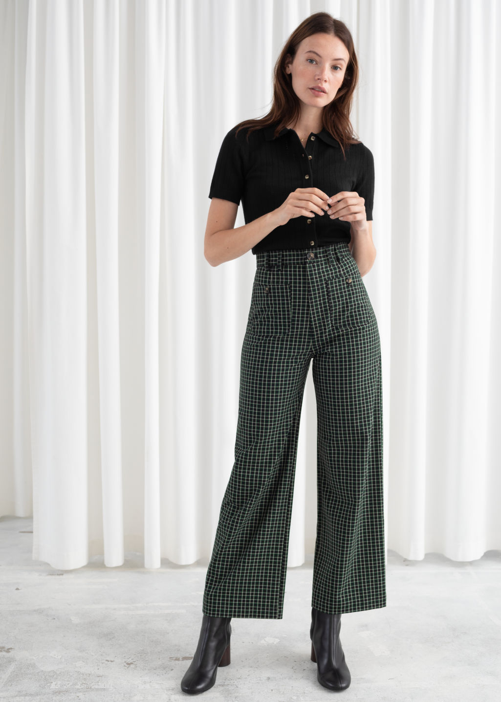 Model front image of Stories kick flare plaid trousers in green