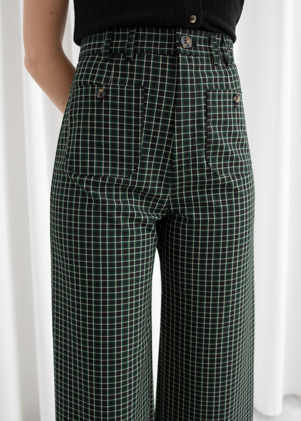 Model back image of Stories kick flare plaid trousers in green
