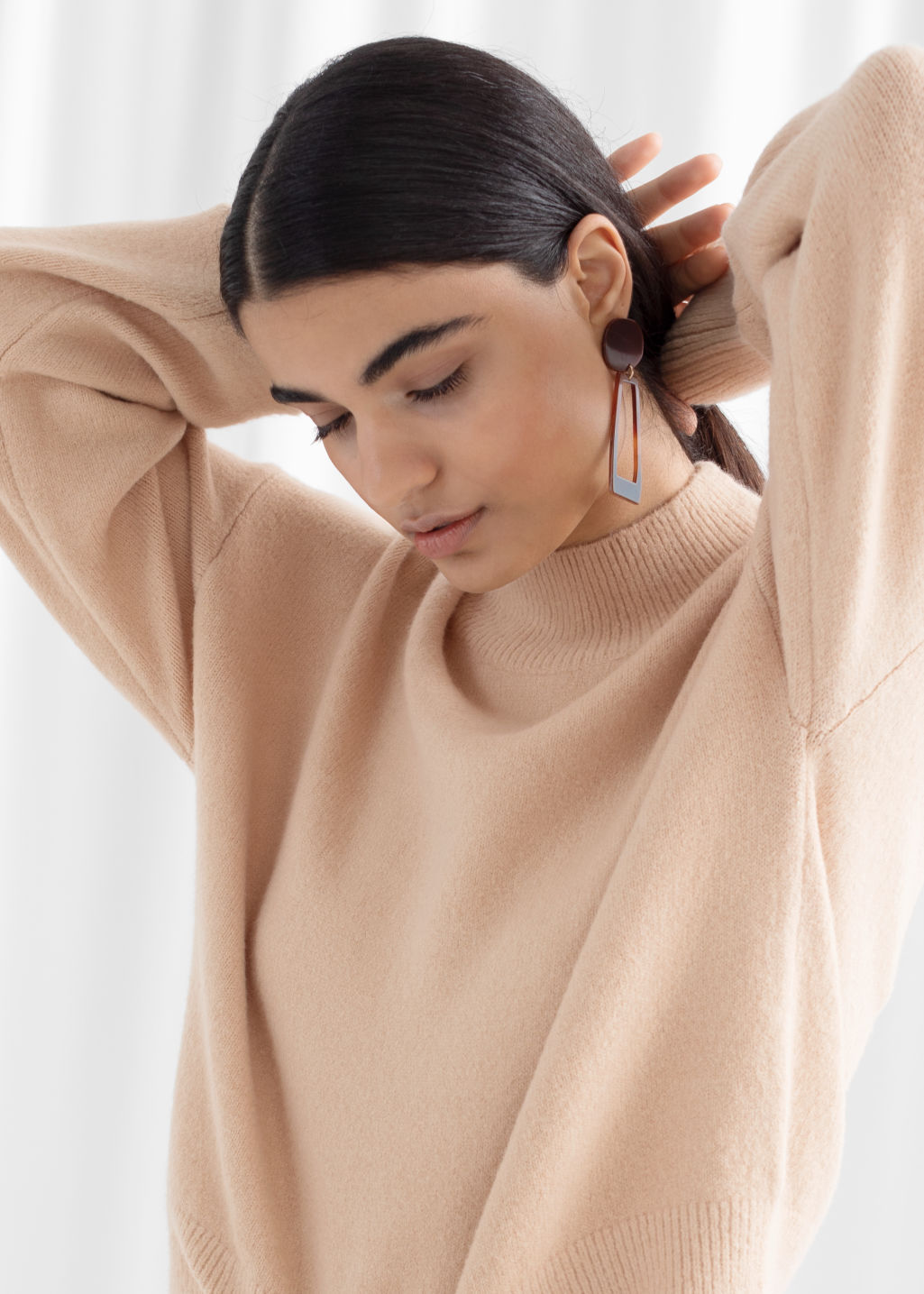Model front image of Stories mock neck sweater in beige