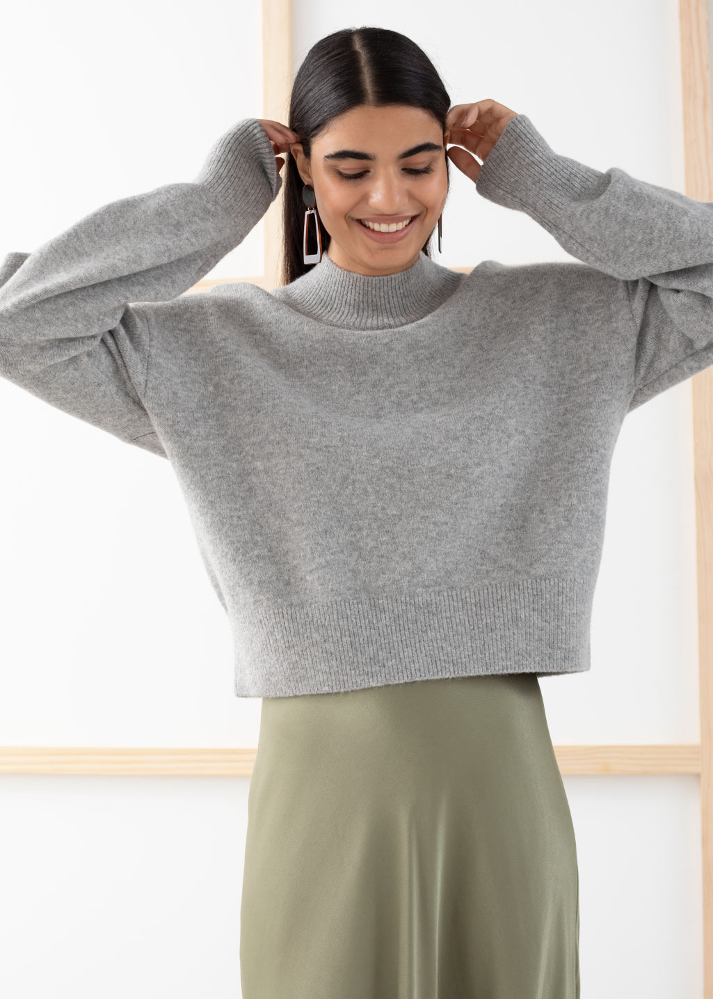 Model front image of Stories mock neck sweater in grey