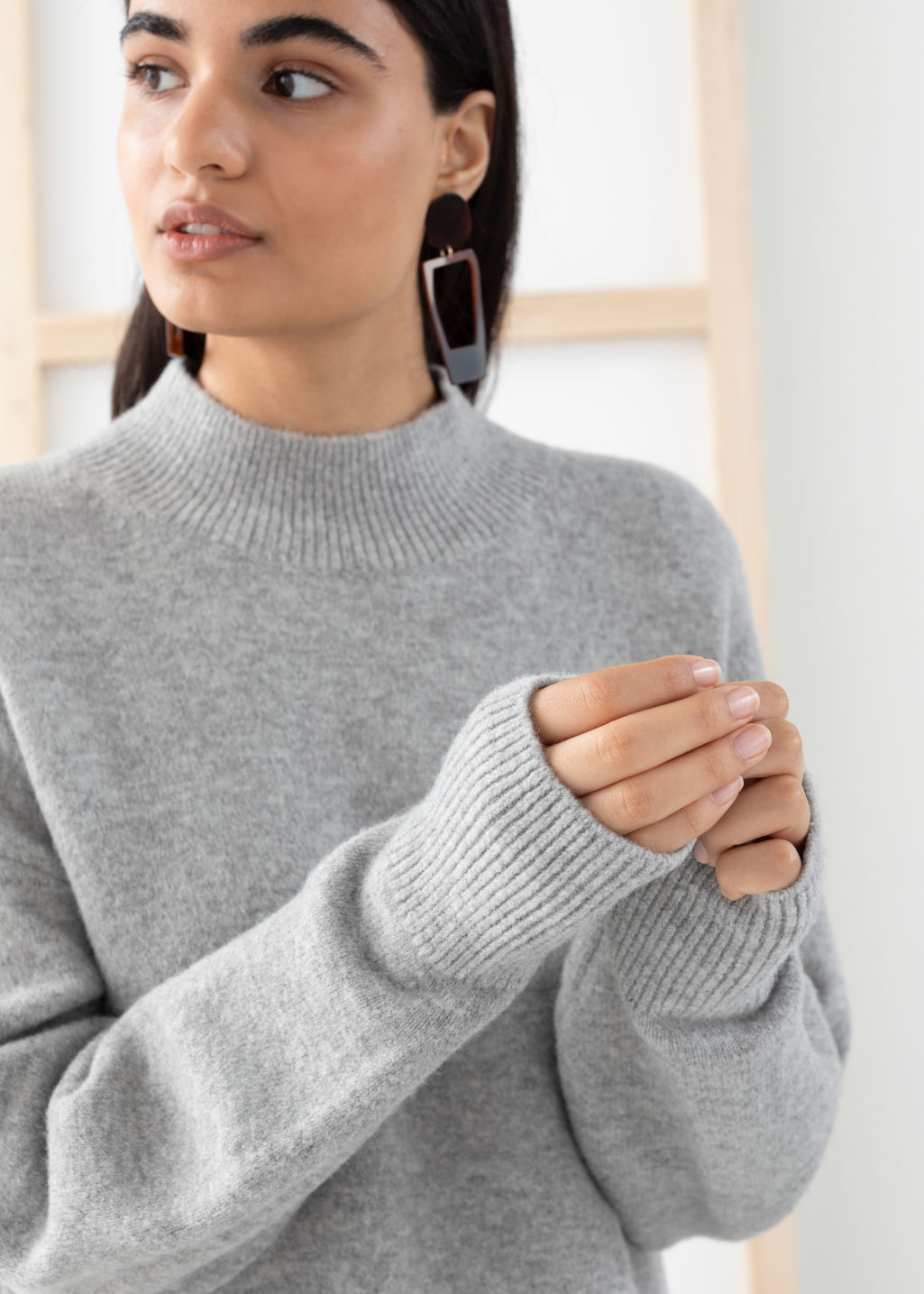 Model side image of Stories mock neck sweater in grey