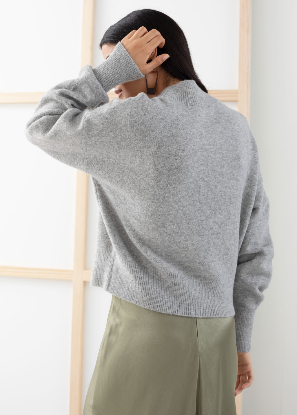 Model back image of Stories mock neck sweater in grey