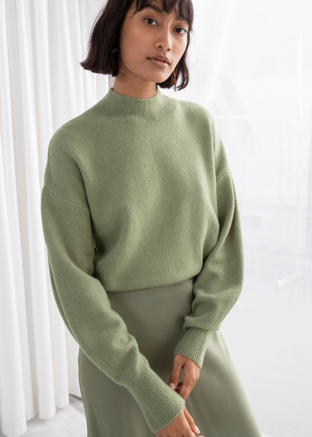 Model front image of Stories mock neck sweater in green