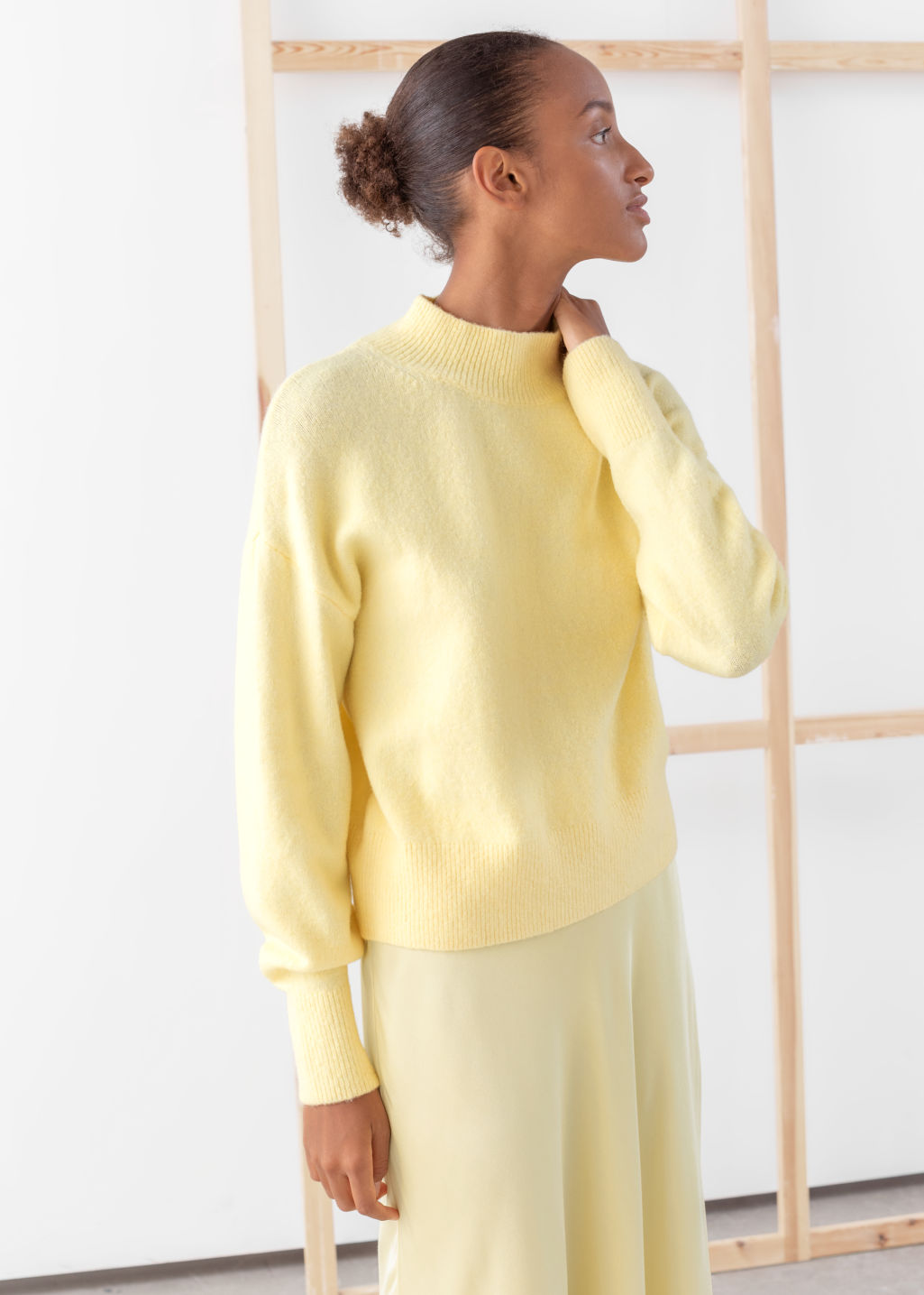 Model front image of Stories mock neck sweater in yellow