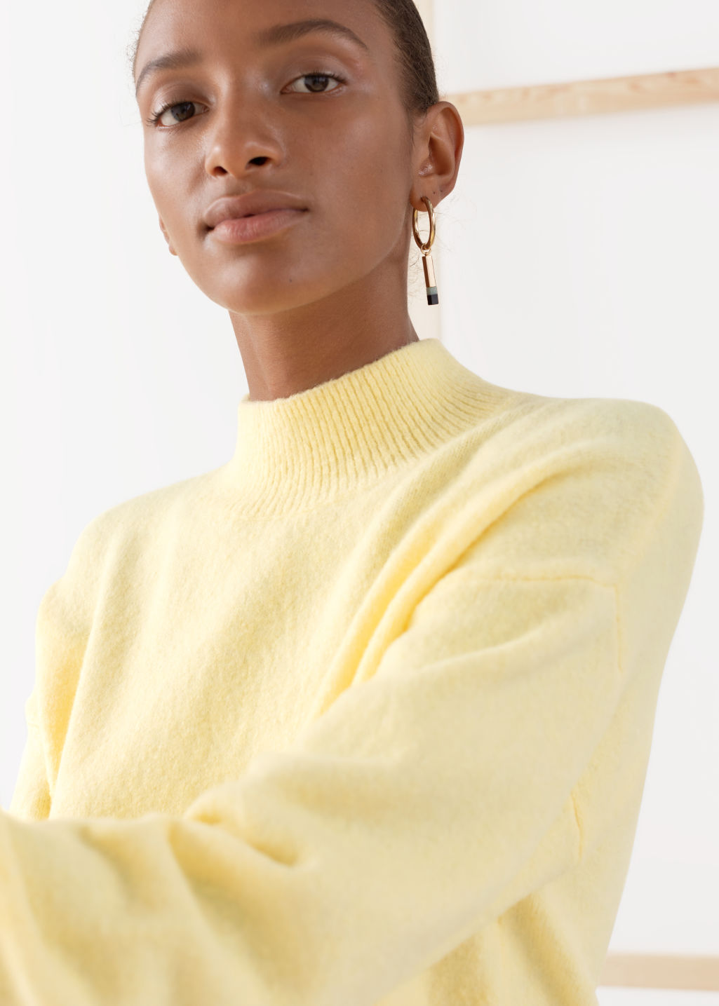 Model back image of Stories mock neck sweater in yellow
