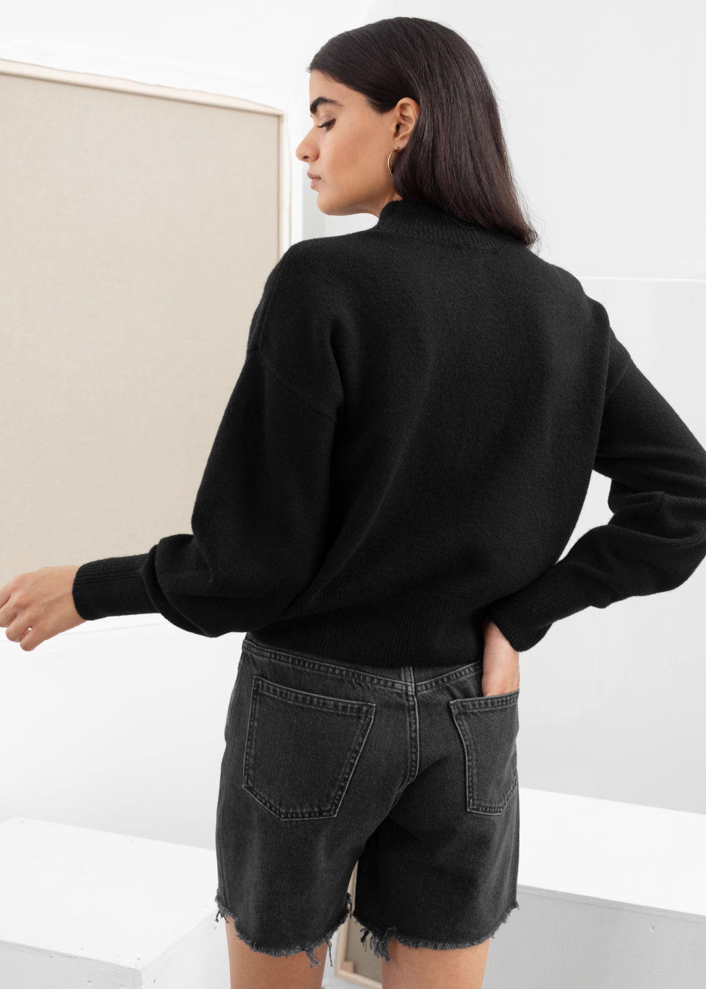 Model back image of Stories mock neck sweater in black