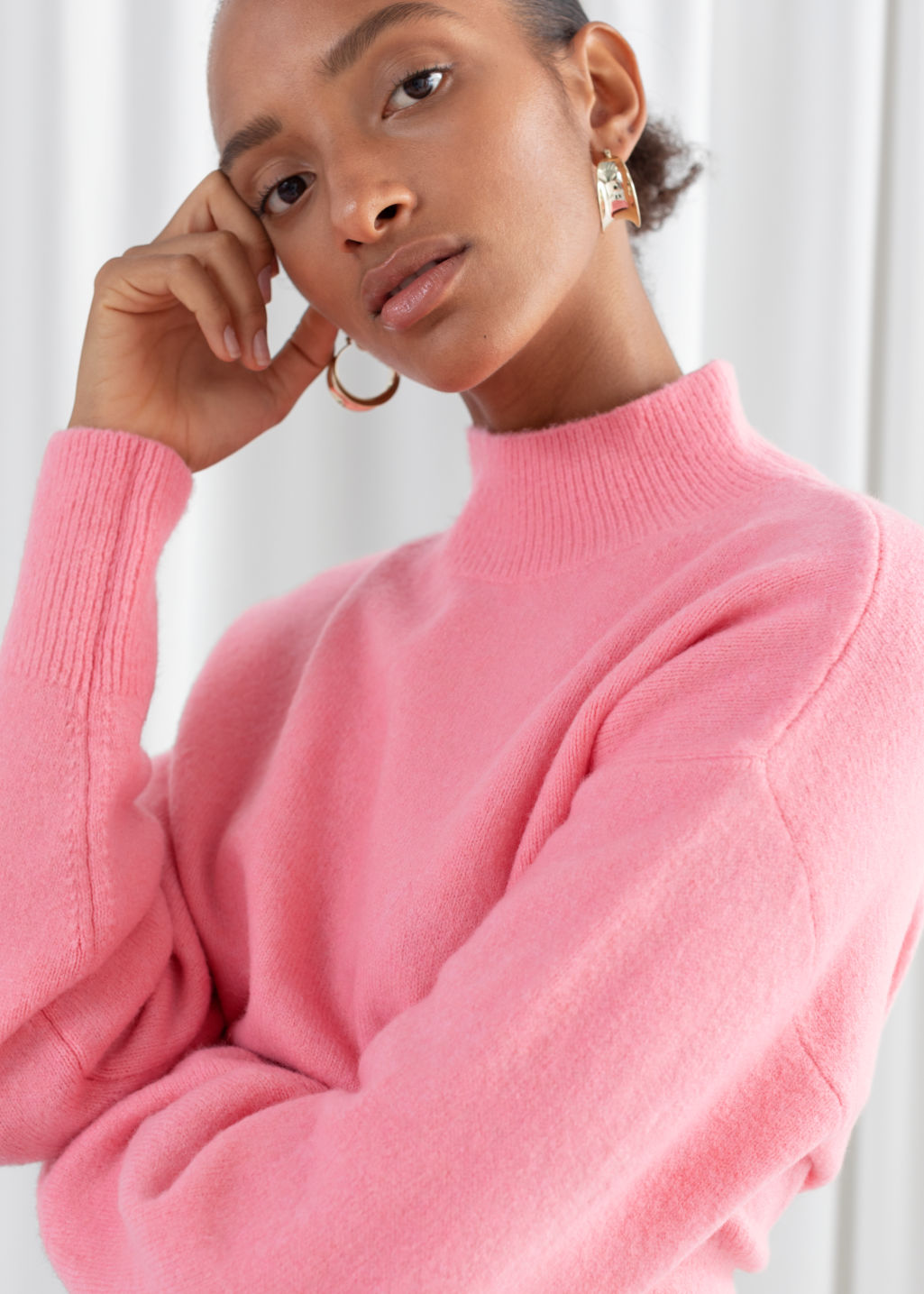 Model front image of Stories mock neck sweater in pink