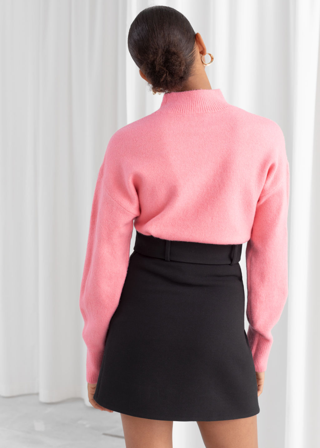 Model back image of Stories mock neck sweater in pink