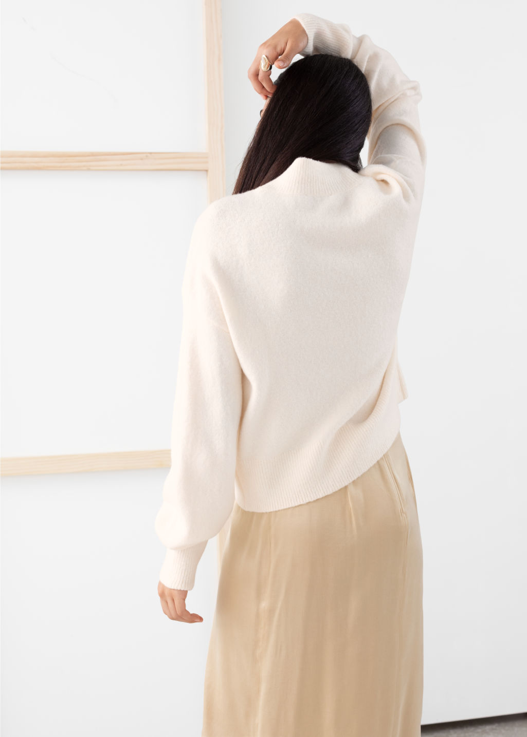 Model back image of Stories mock neck sweater in white