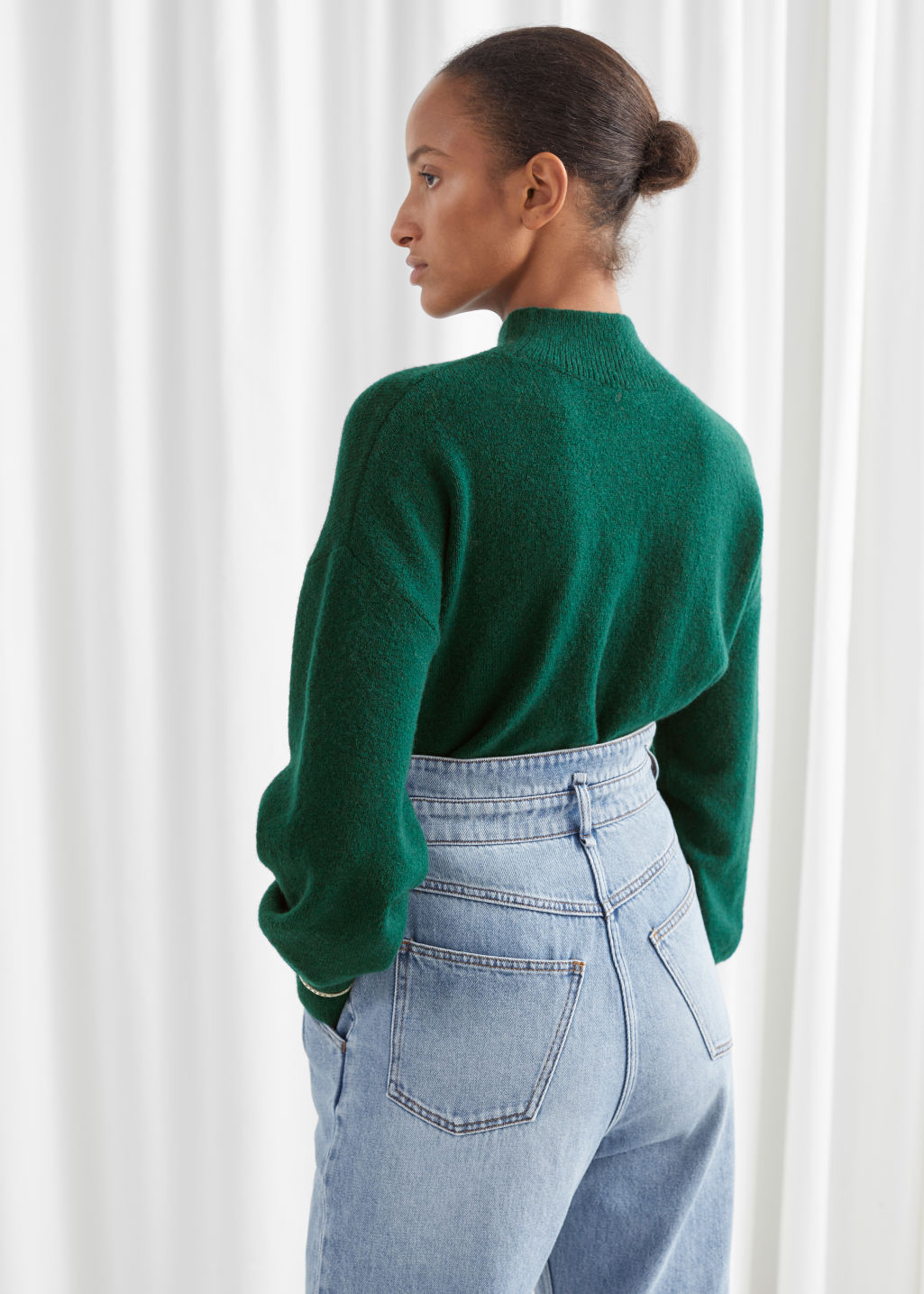 Model back image of Stories mock neck sweater in green