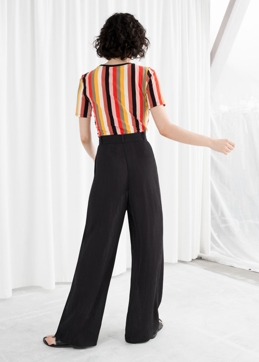 Model back image of Stories high waisted wide trousers in black