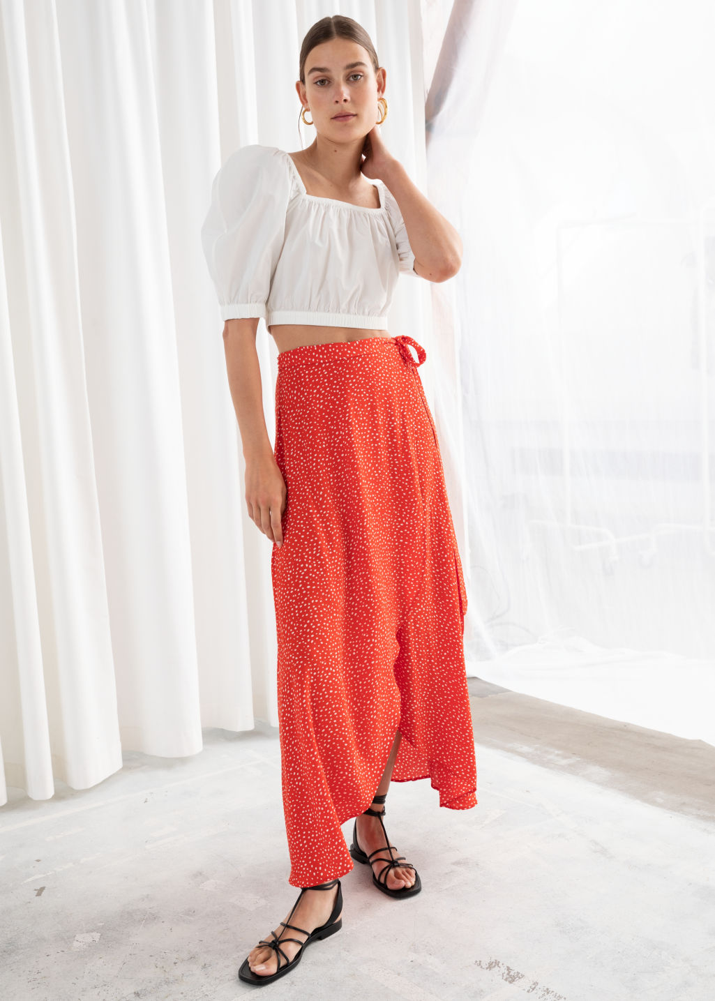 Model front image of Stories asymmetric wrap midi skirt in red