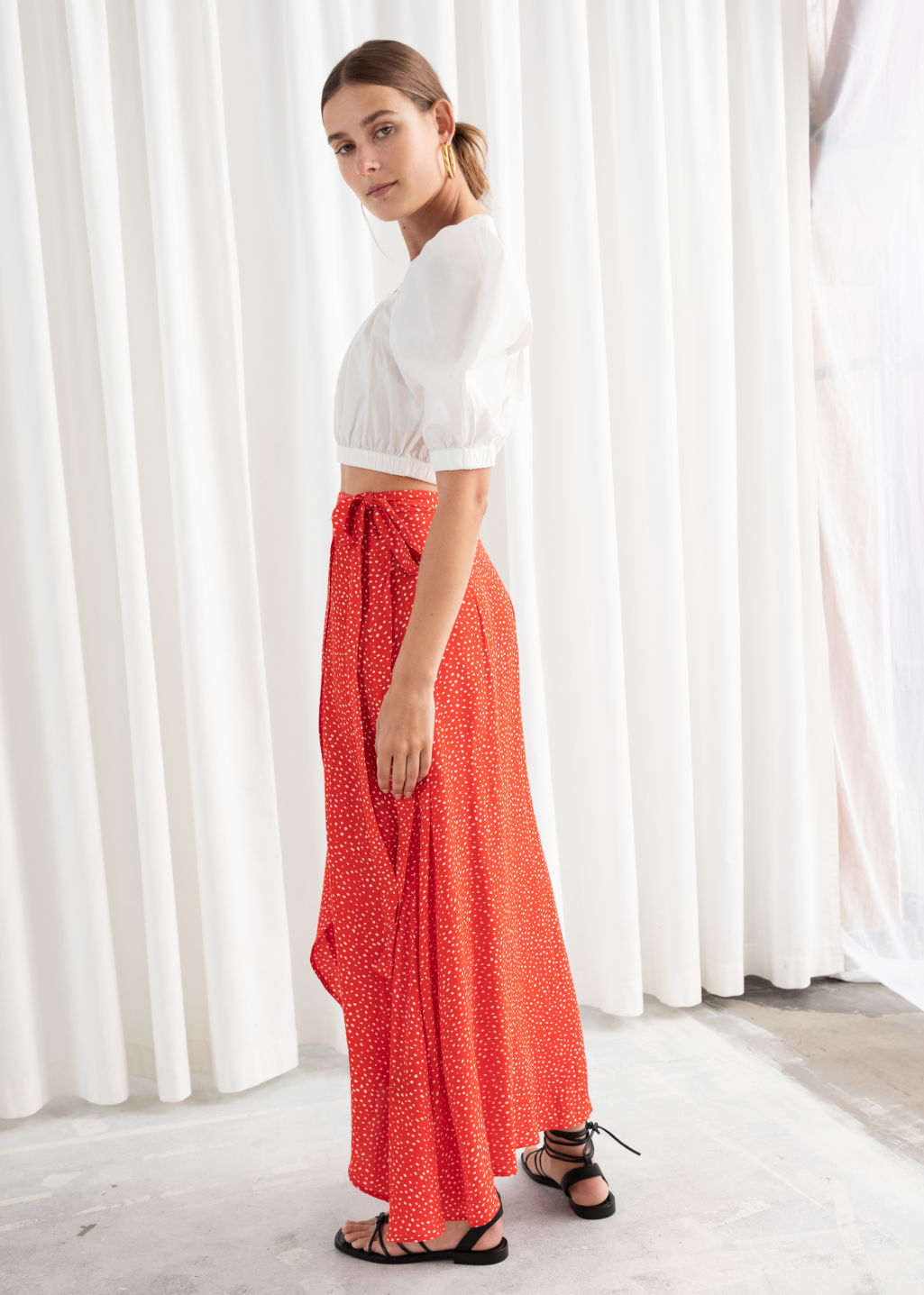 Model back image of Stories asymmetric wrap midi skirt in red