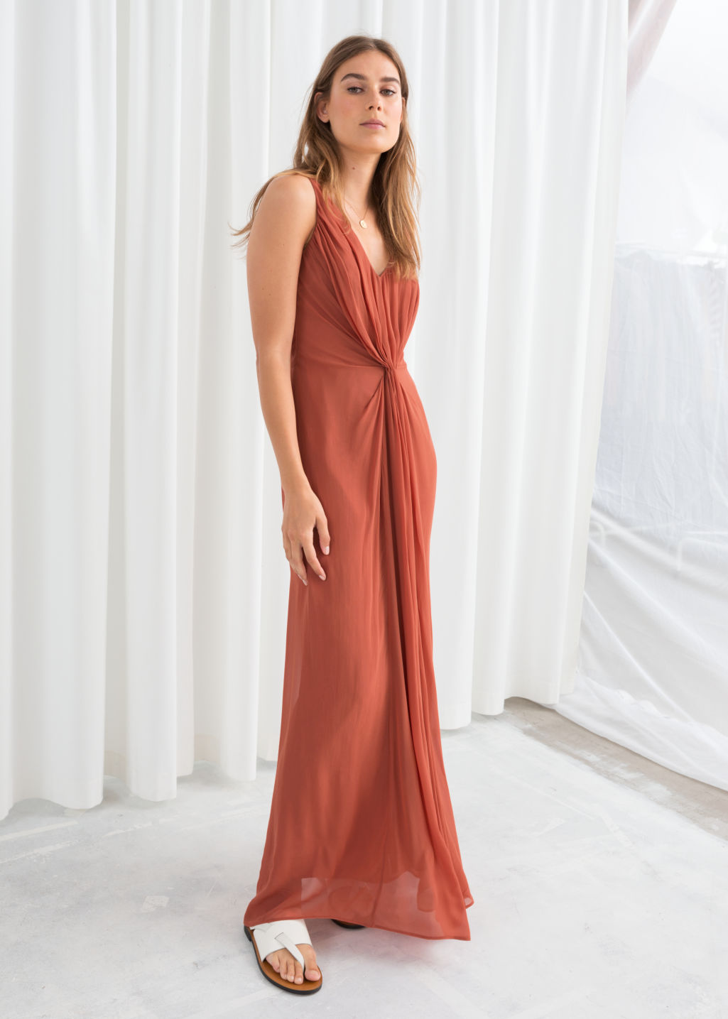 Model front image of Stories knotted maxi dress in orange