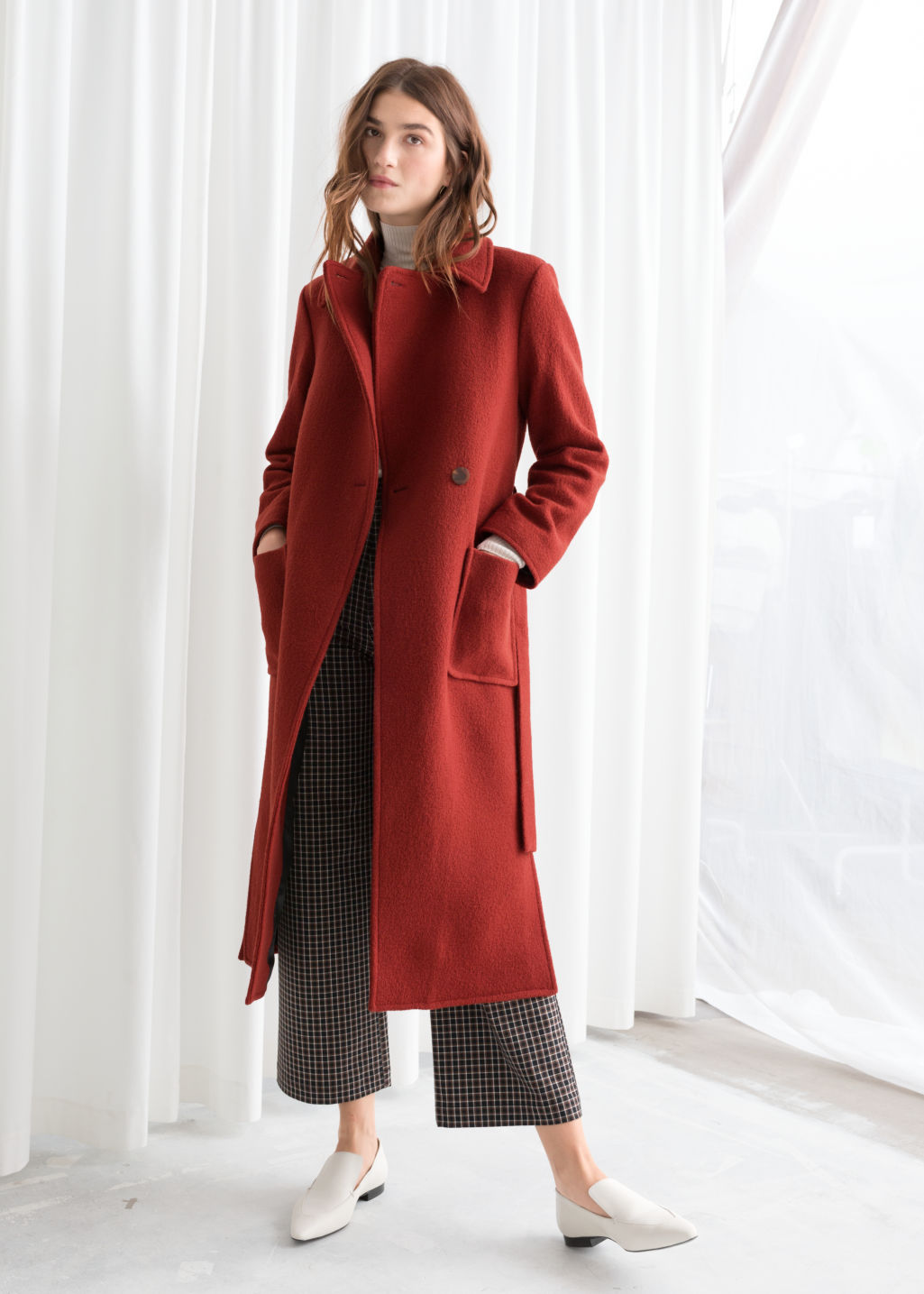 Model front image of Stories belted wool coat in red