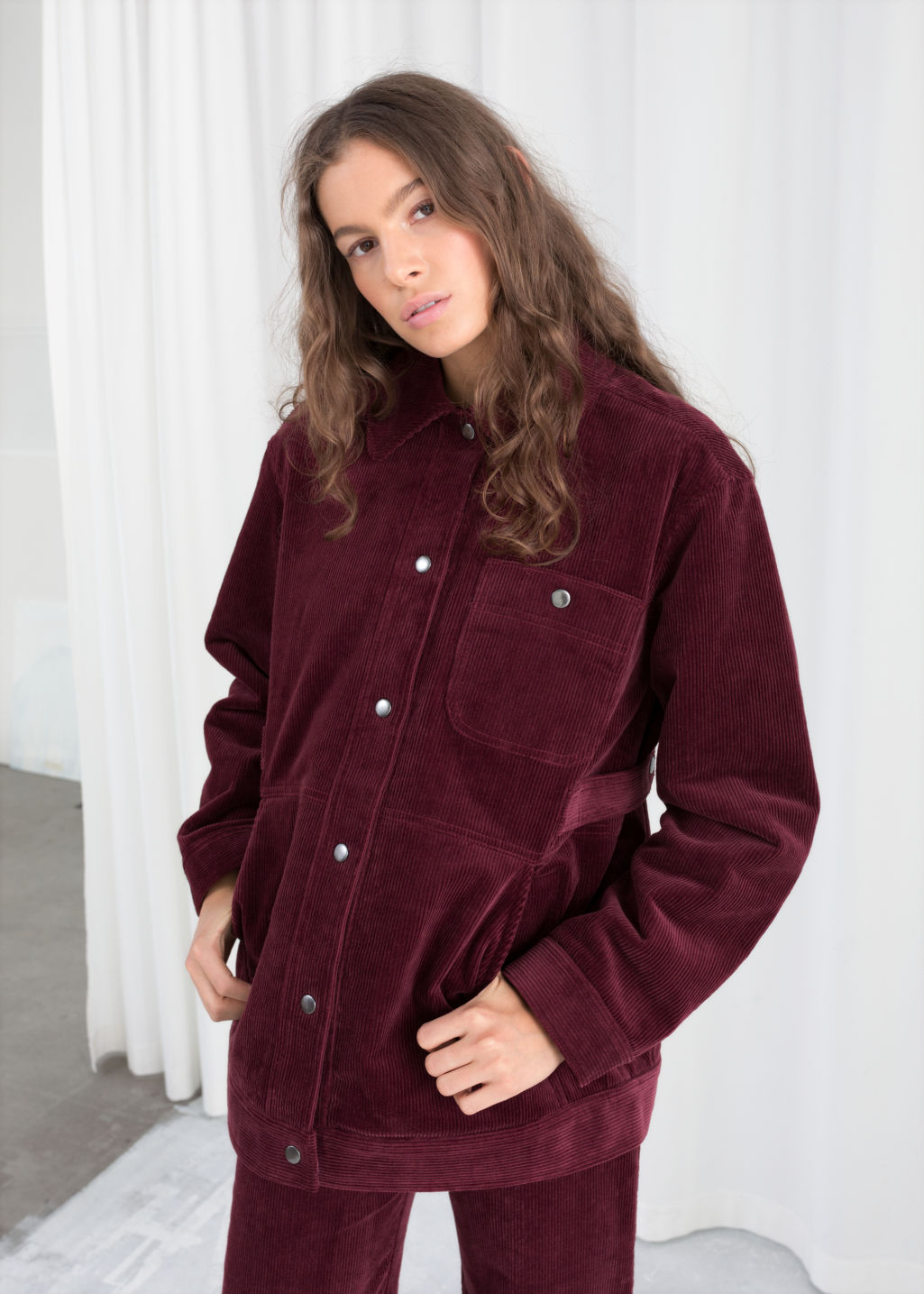 Model front image of Stories oversized corduroy workwear jacket in red
