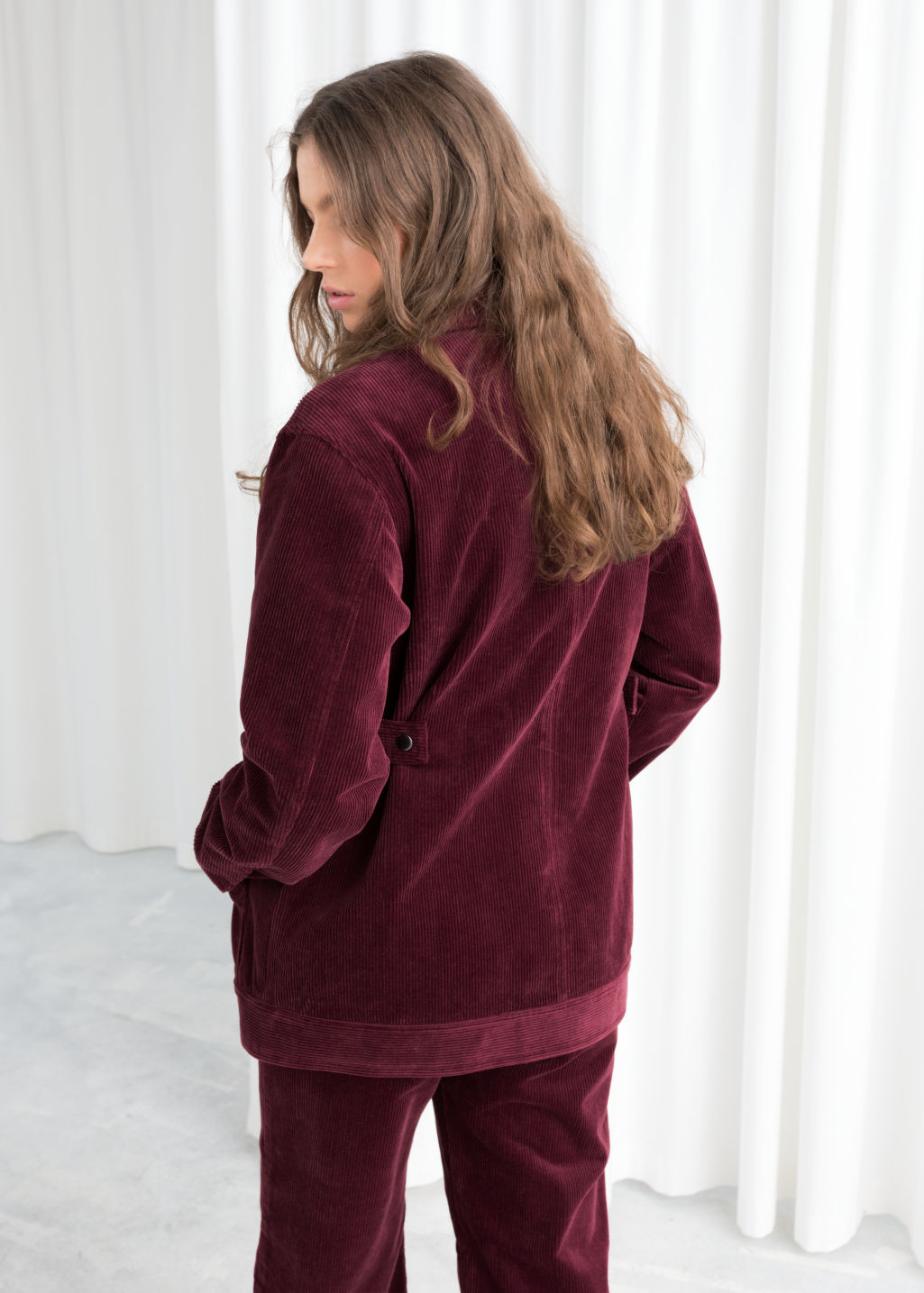 Model back image of Stories oversized corduroy workwear jacket in red