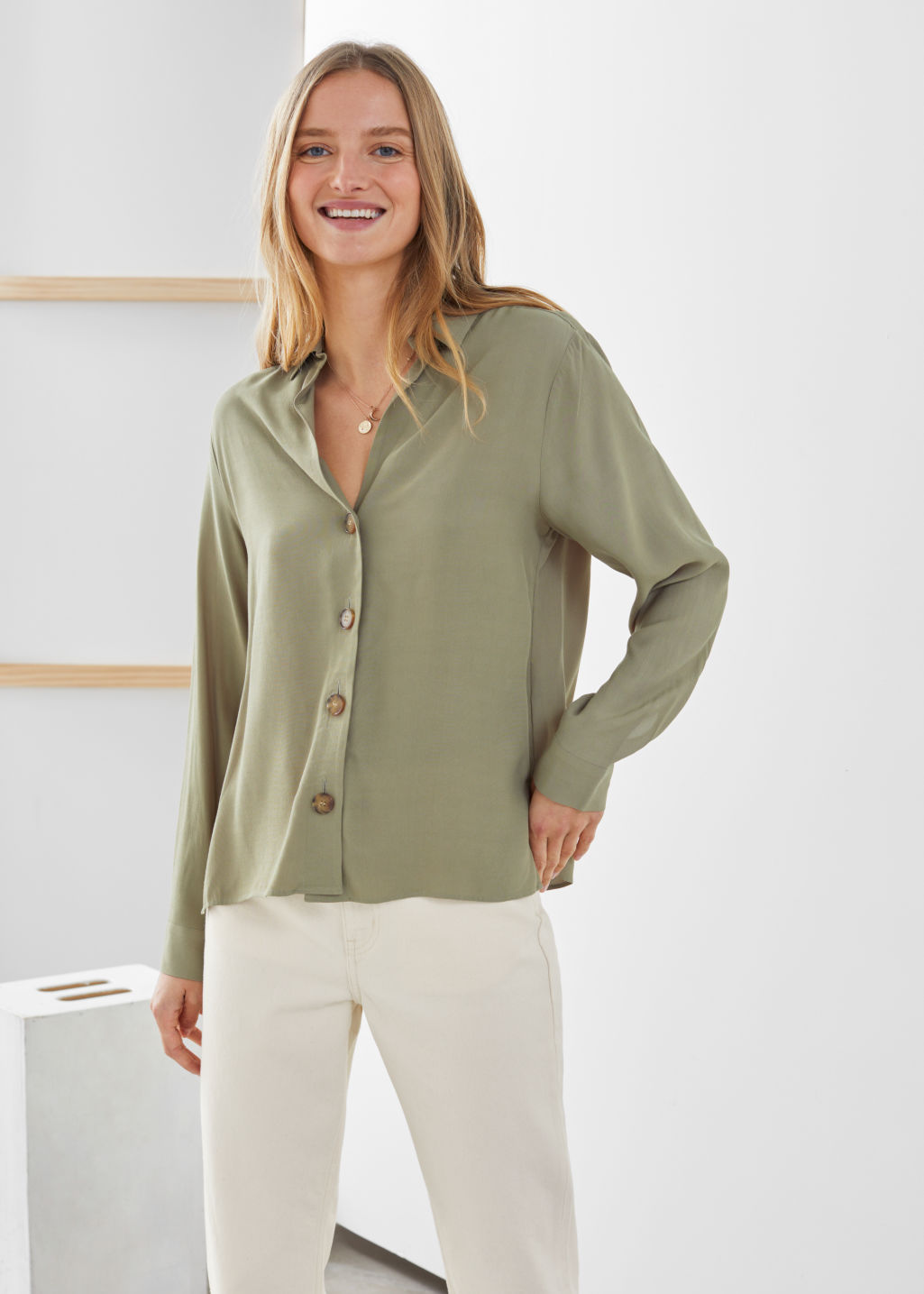 Model front image of Stories relaxed fit button up in green