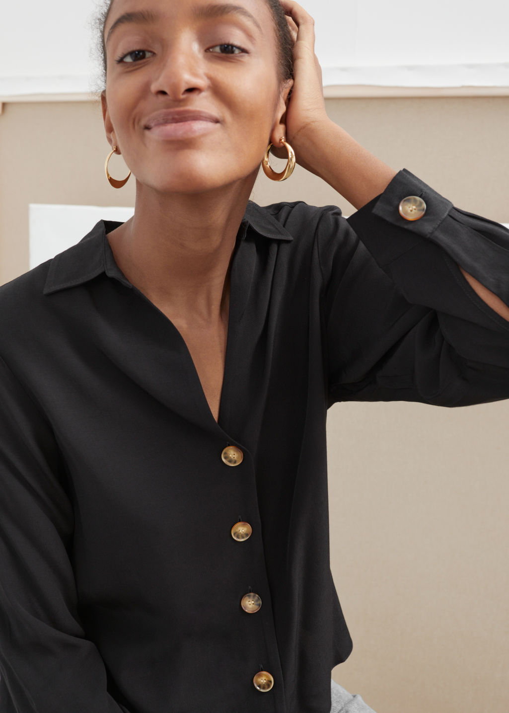 Model front image of Stories relaxed fit button up in black
