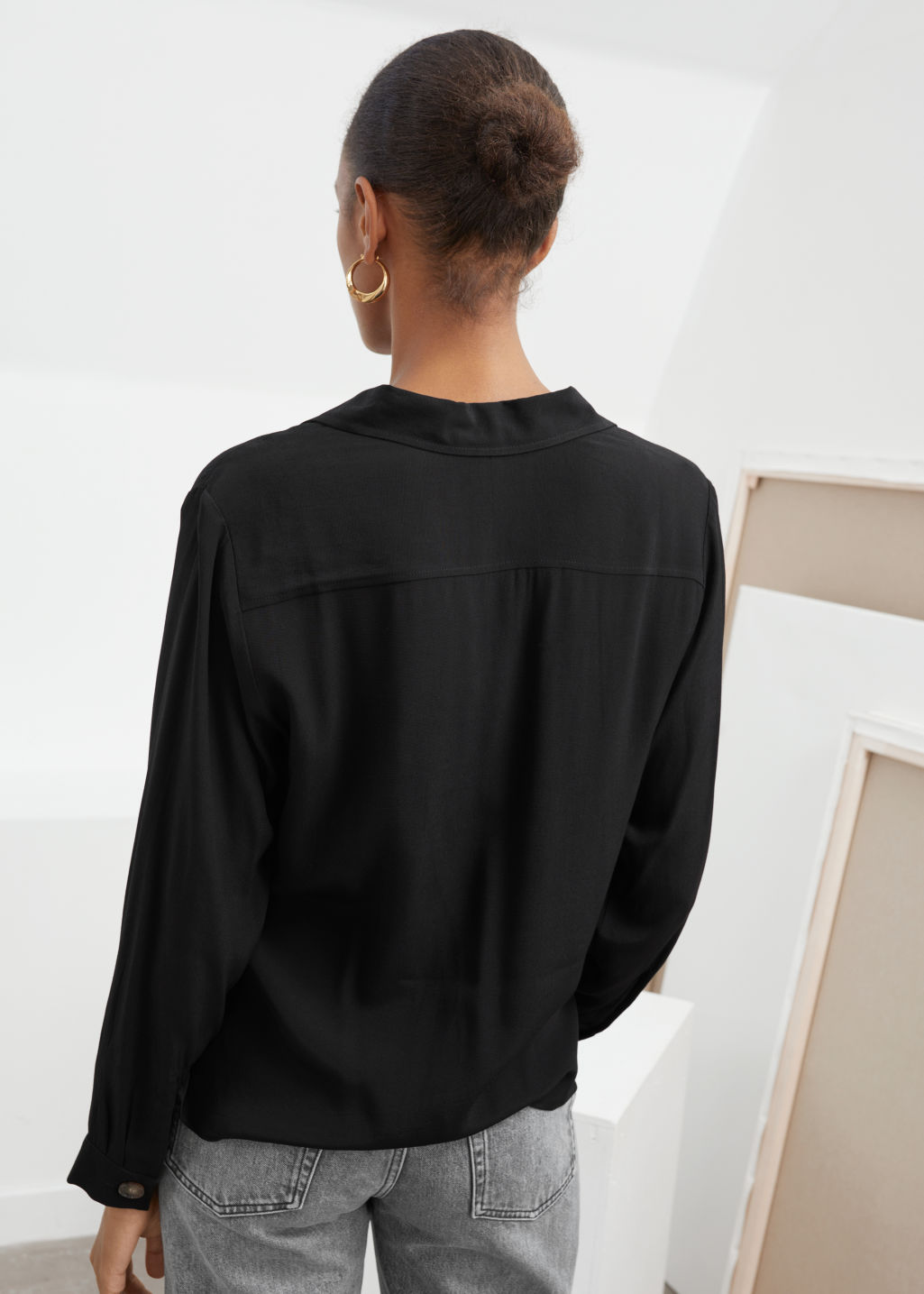 Model back image of Stories relaxed fit button up in black