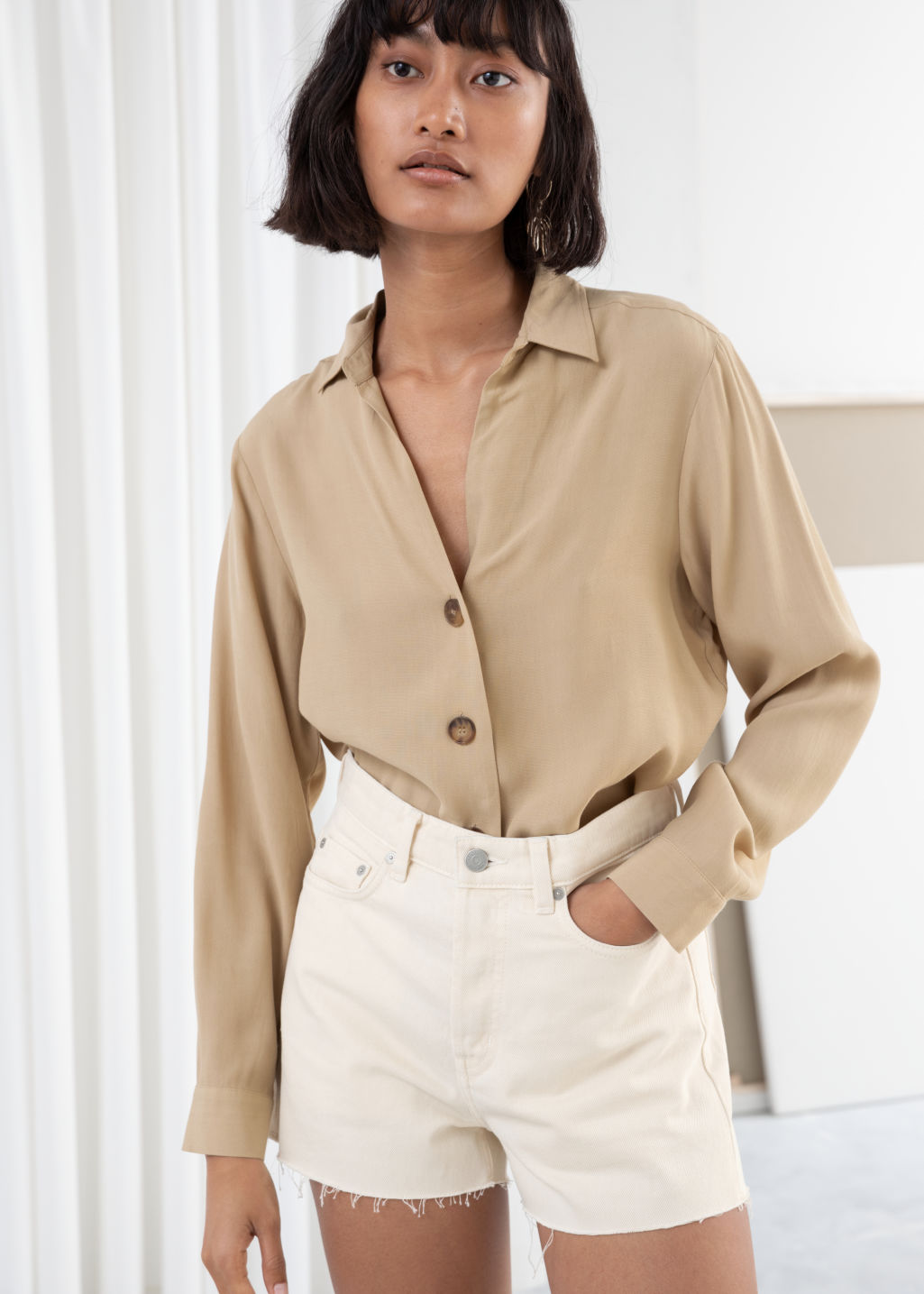 Model front image of Stories relaxed fit button up in beige