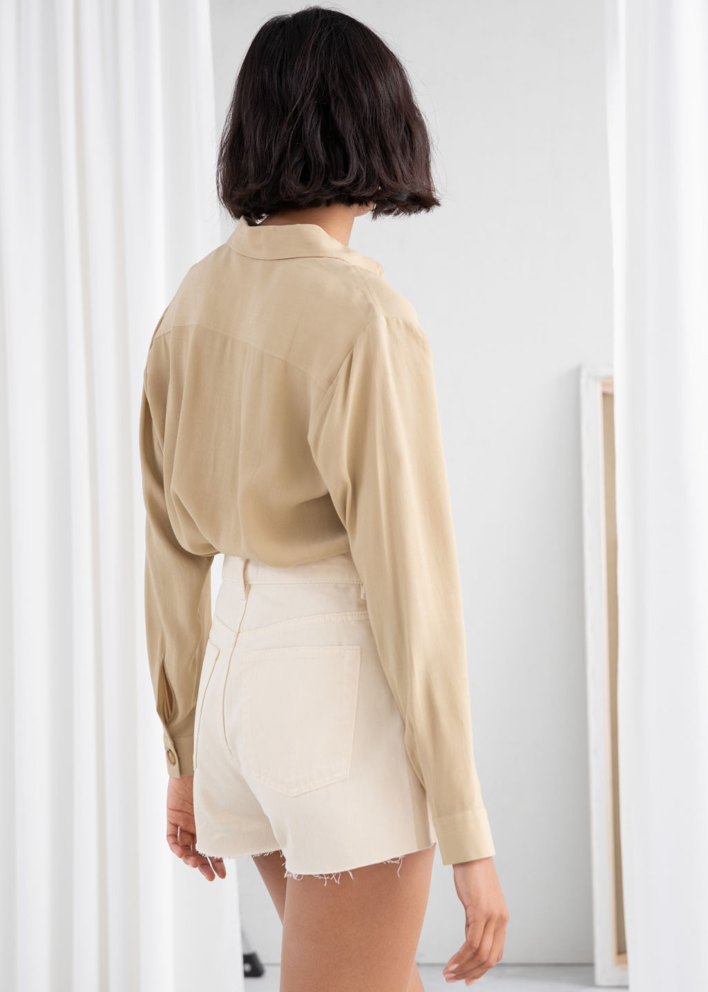 Model back image of Stories relaxed fit button up in beige