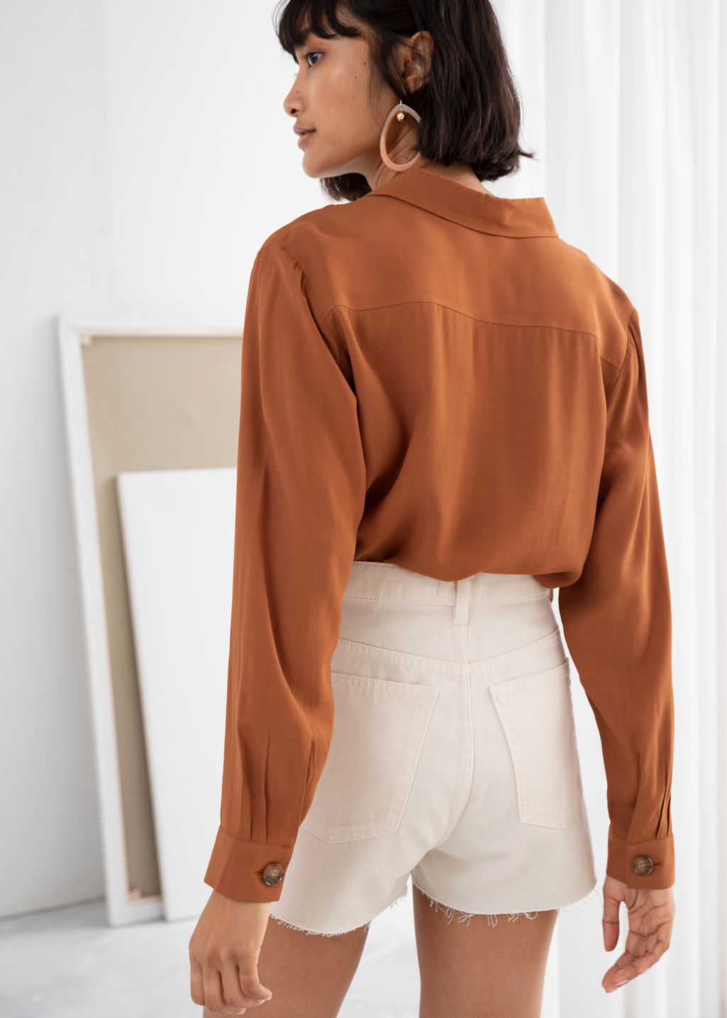 Model back image of Stories relaxed fit button up in orange