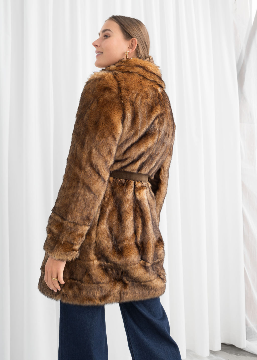 Model back image of Stories belted faux fur coat in beige