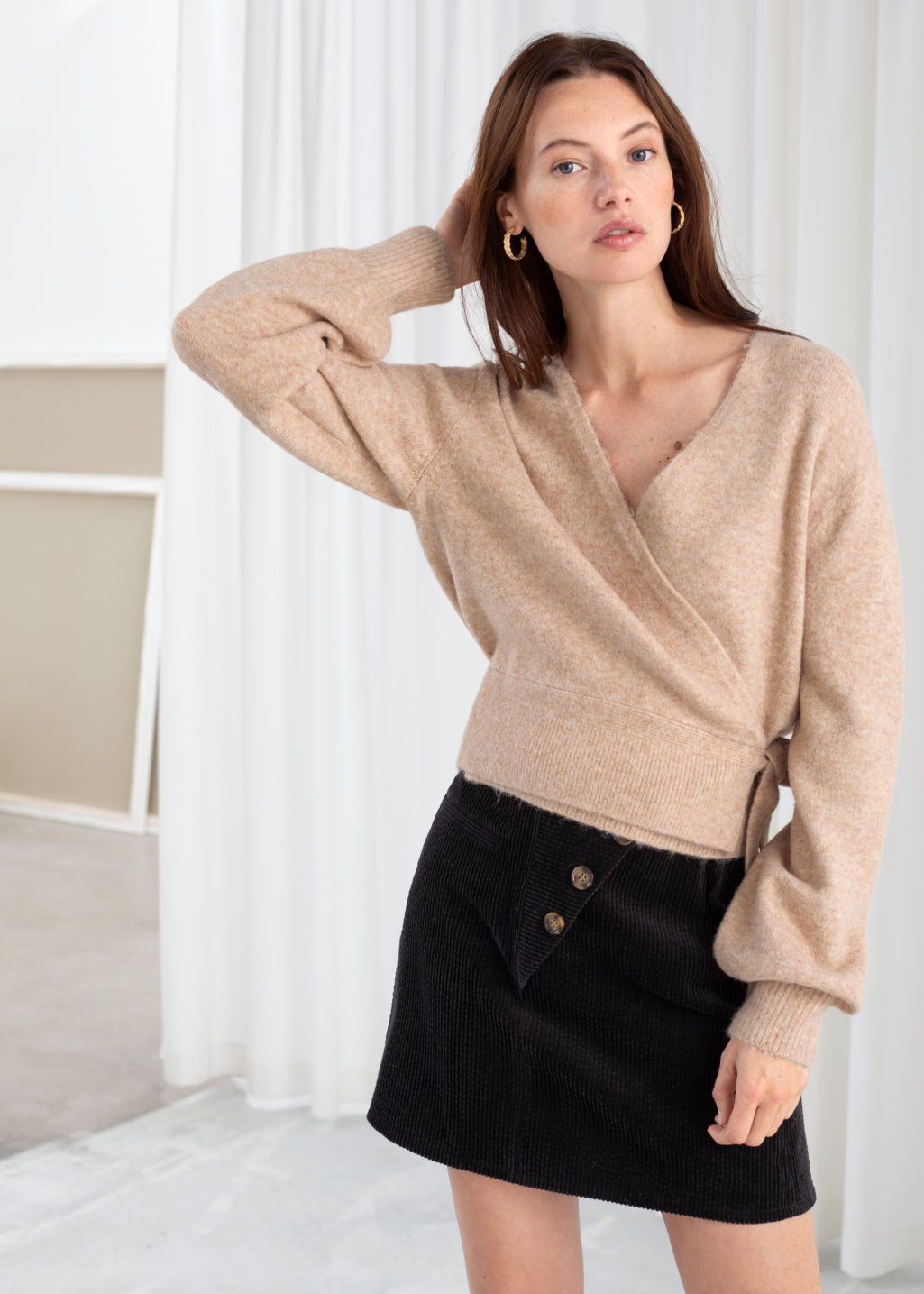 Model front image of Stories wrap cardigan in beige