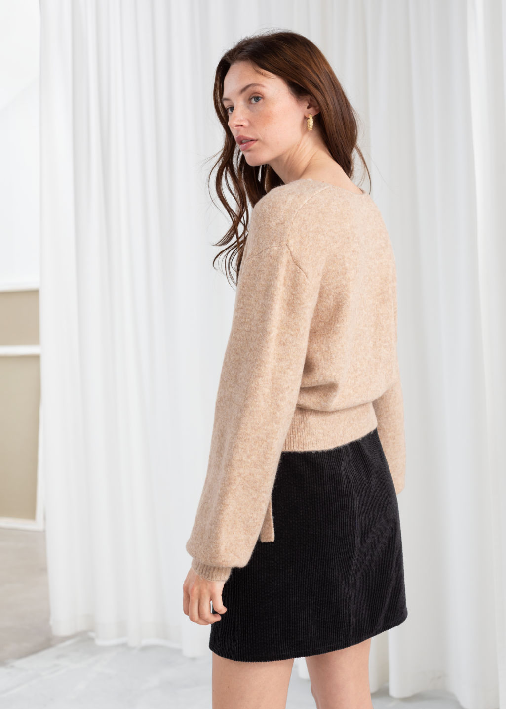 Model back image of Stories wrap cardigan in beige