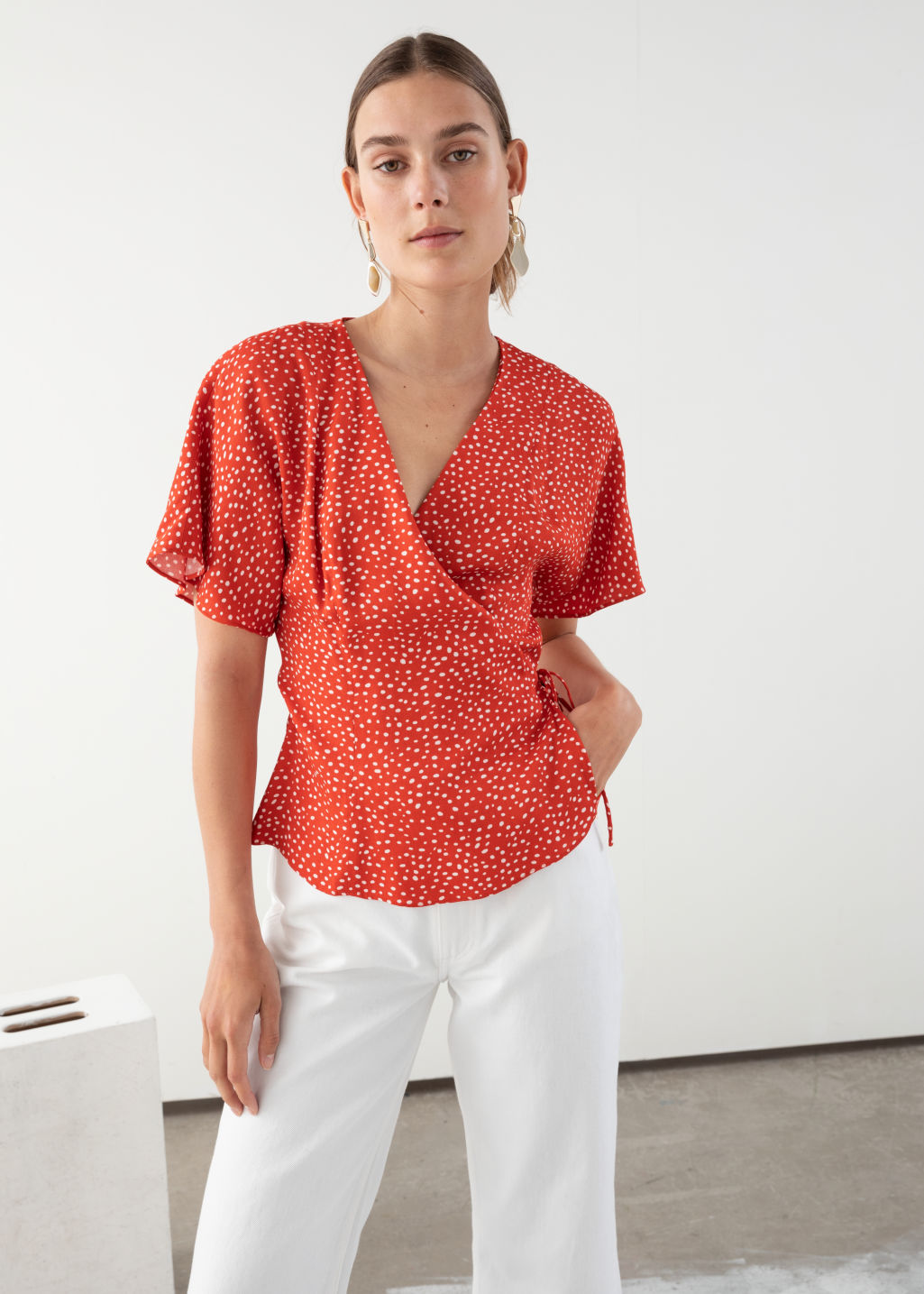 Model front image of Stories printed wrap blouse  in red