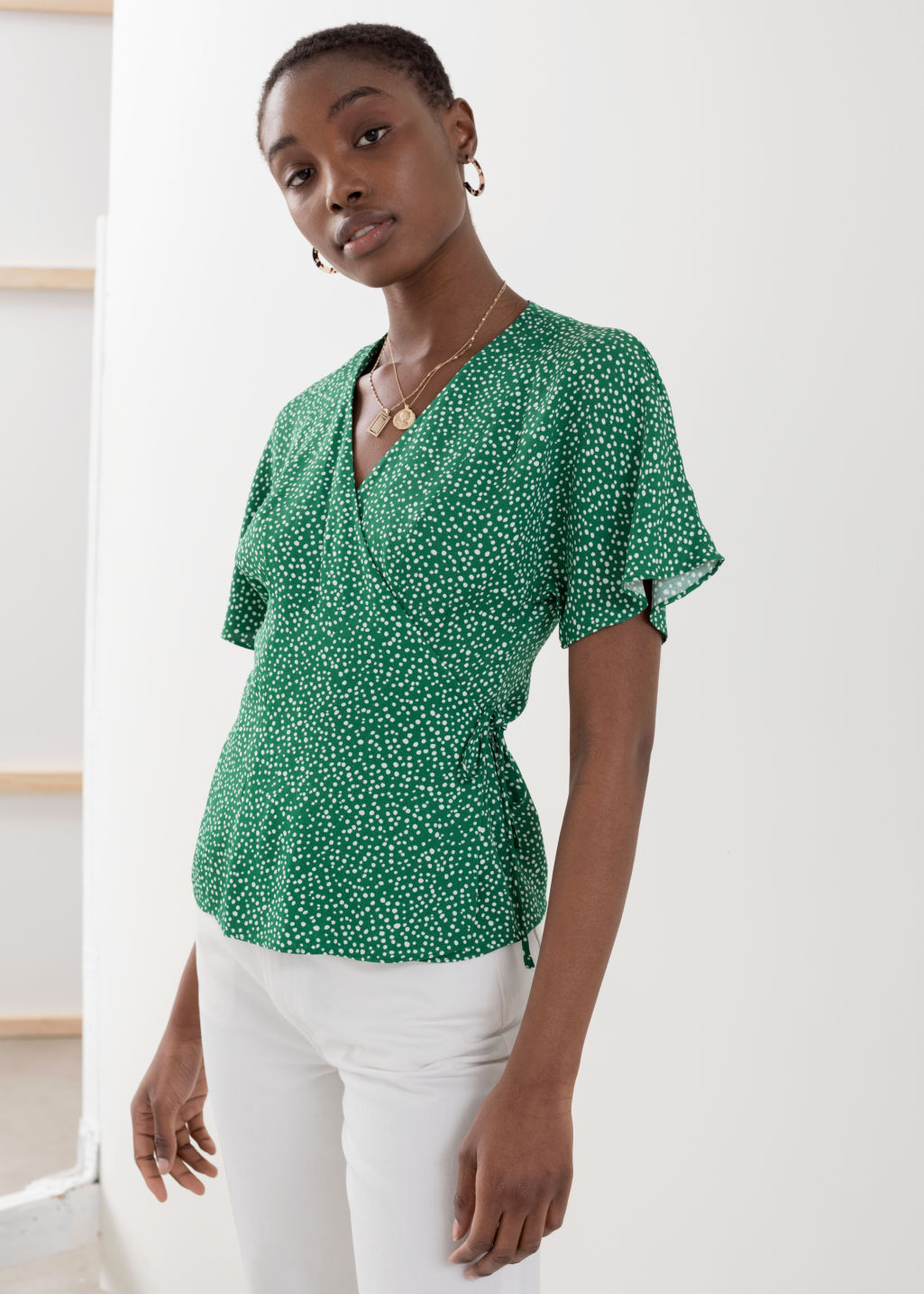Model front image of Stories printed wrap blouse  in green