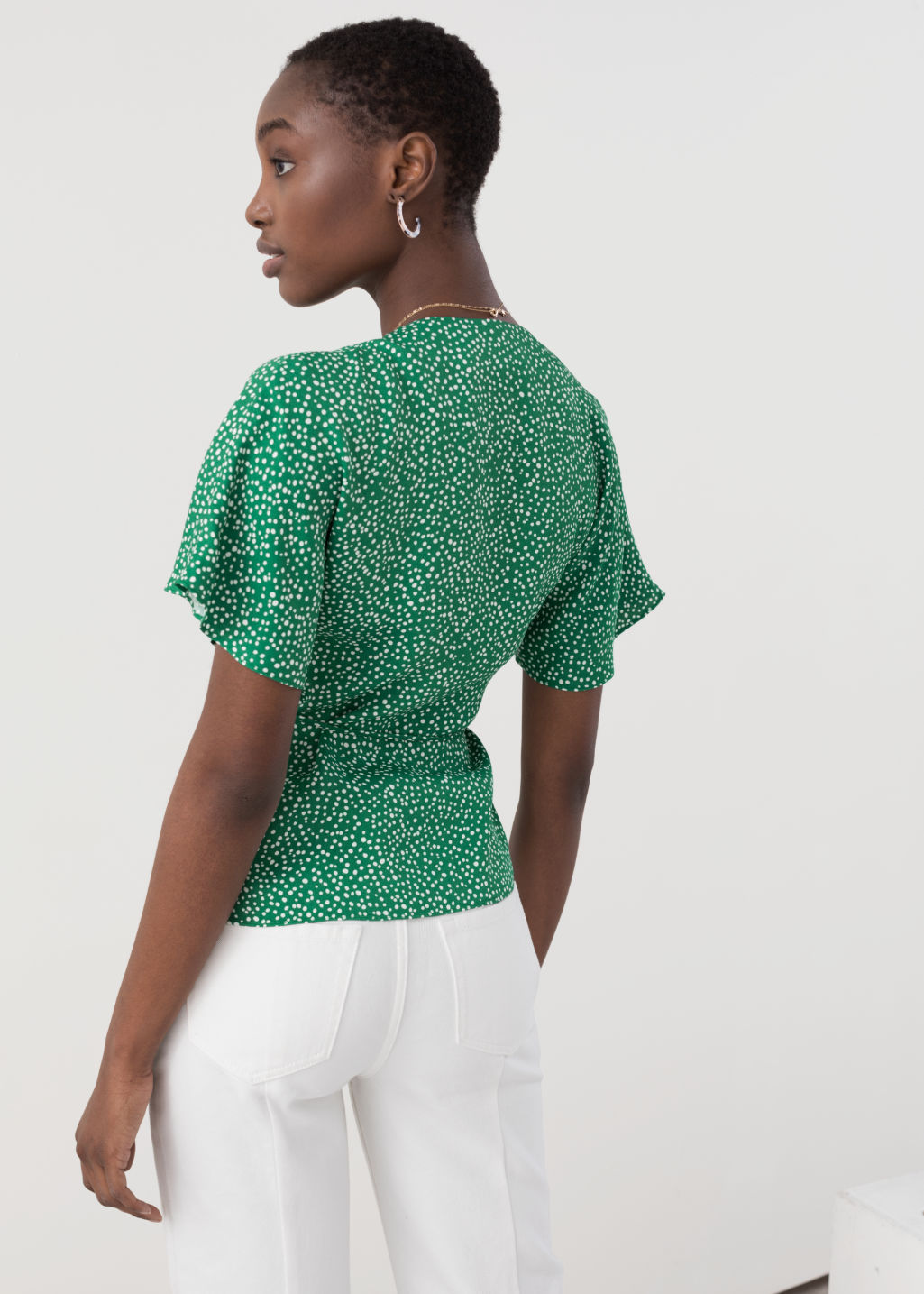 Model back image of Stories printed wrap blouse  in green