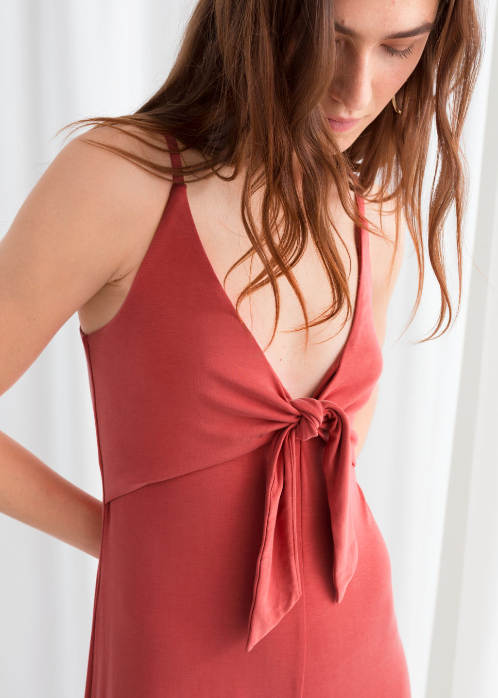 Model back image of Stories tie up flared jumpsuit in red