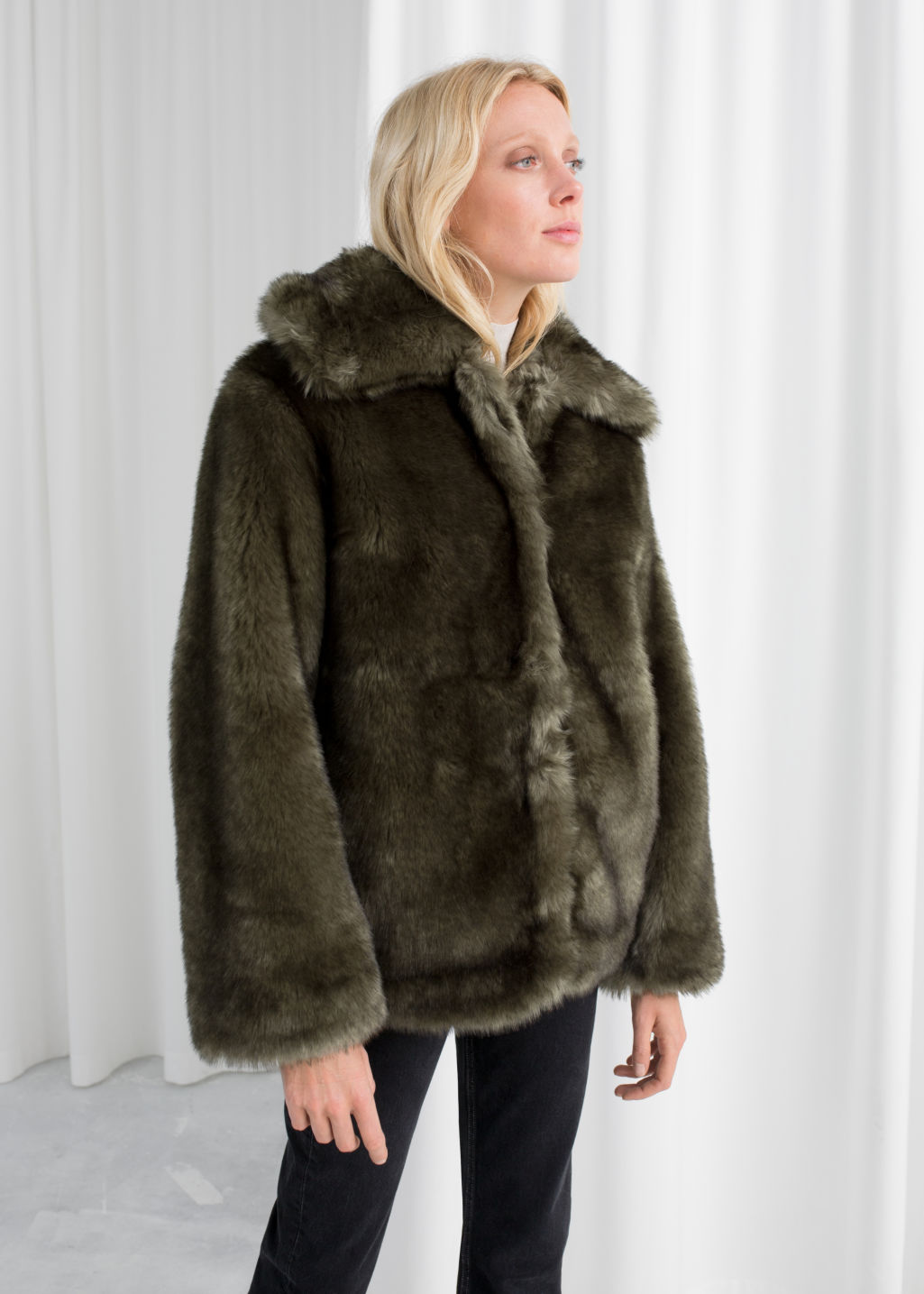 Model front image of Stories short faux fur jacket in green