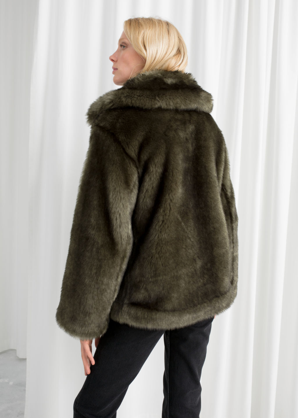 Model back image of Stories short faux fur jacket in green